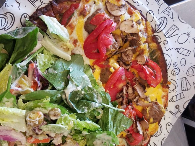 Housemade crust with half salad, half pizza from Azzip Pizza.