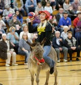 Waupun FFA battled Waupun High School staff in Donkey Basketball for playground equipment fundraiser.