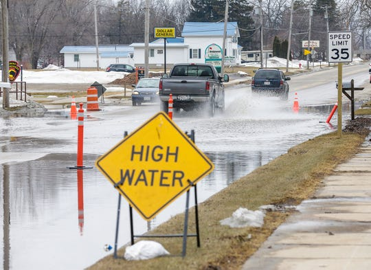 Water covers State 21 near Lincoln Street in Omro. Flooding of the Fox River forced the closure of a portion of Highway 21 Wednesday in Omro.
