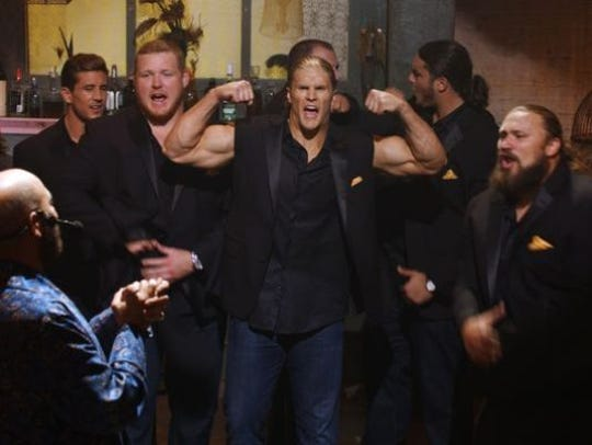 "Clay Matthews shows off his guns in a scene from ""Pitch Perfect 2."""
