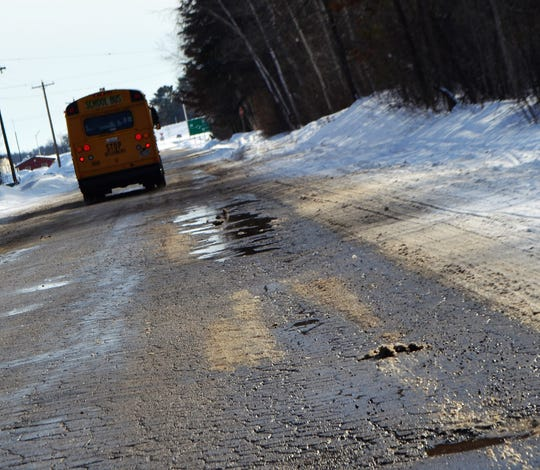 A school bus on Van Hecke Avenue in Oconto heads toward HIghway 22 in early March. The roadway will be reconstructed this summer.