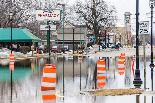 Water covers State 21 in Omro. Flooding of the Fox River closed a portion of the highway Wednesday in Omro. There is a flood warning for the city.