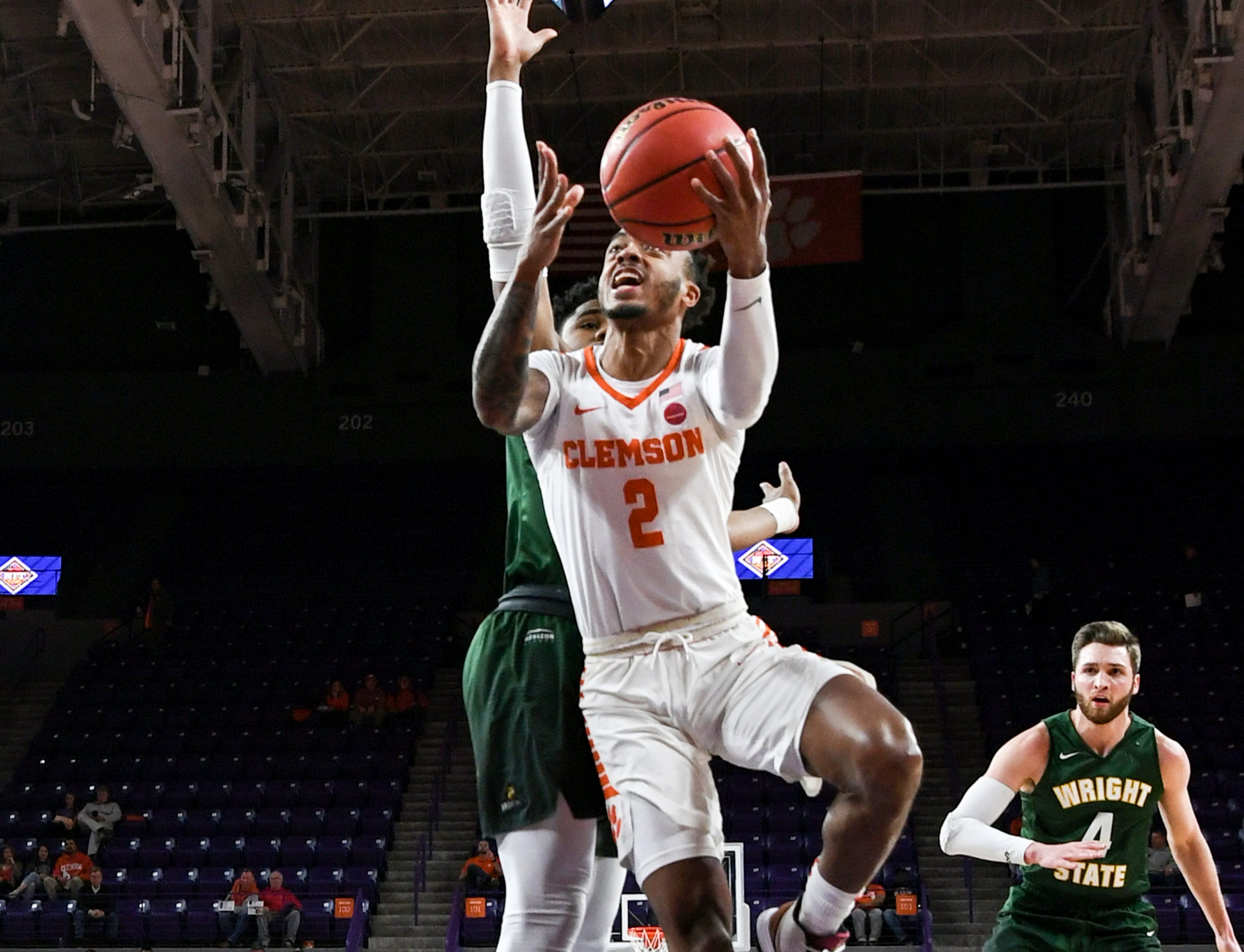 Clemson guard Marcquise Reed (2) shoots near Wright State guard Alan Vest(4) during the first half of the NIT at Littlejohn Coliseum in Clemson Tuesday, March 19, 2019.
