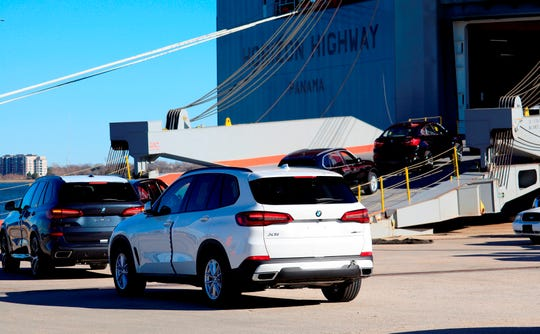 In this file photo, BMWs roll onto a transport ship in Charleston bound for oversees markets.