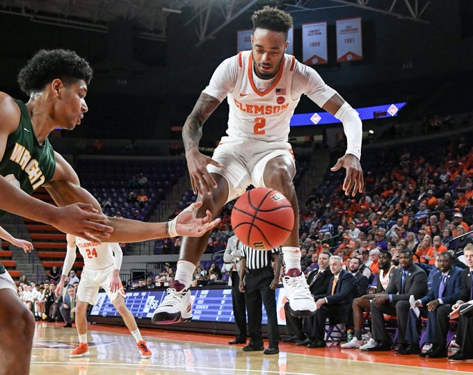 Clemson guard Marcquise Reed (2) jumps near a loose ball and Wright State guard Malachi Smith(13) during the second half of the NIT at Littlejohn Coliseum in Clemson Tuesday, March 19, 2019.