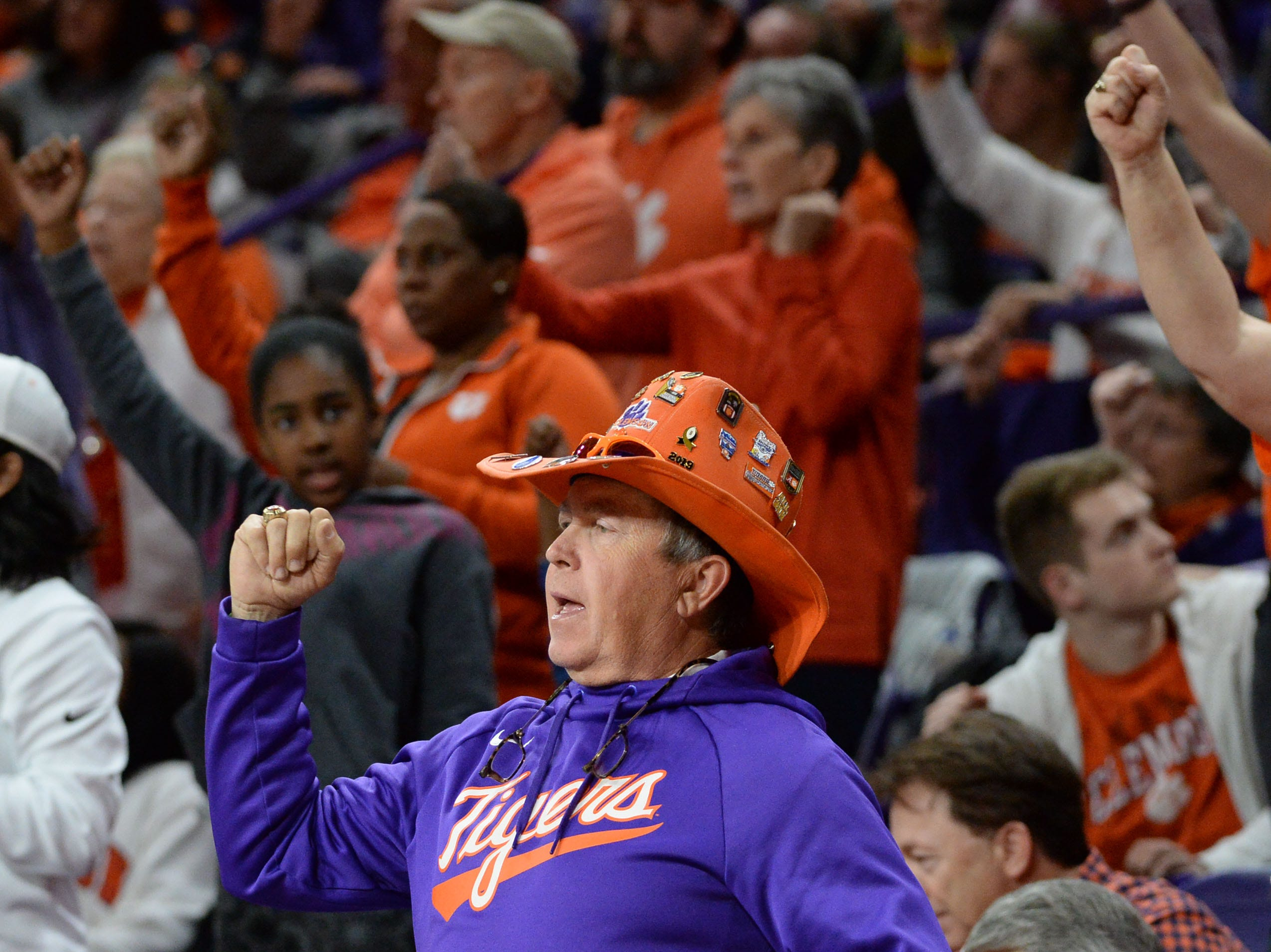 """Dean """"The Hat"""" Cox cheers with Clemson fans during the second half of the NIT with Wright State at Littlejohn Coliseum in Clemson Tuesday, March 19, 2019."""