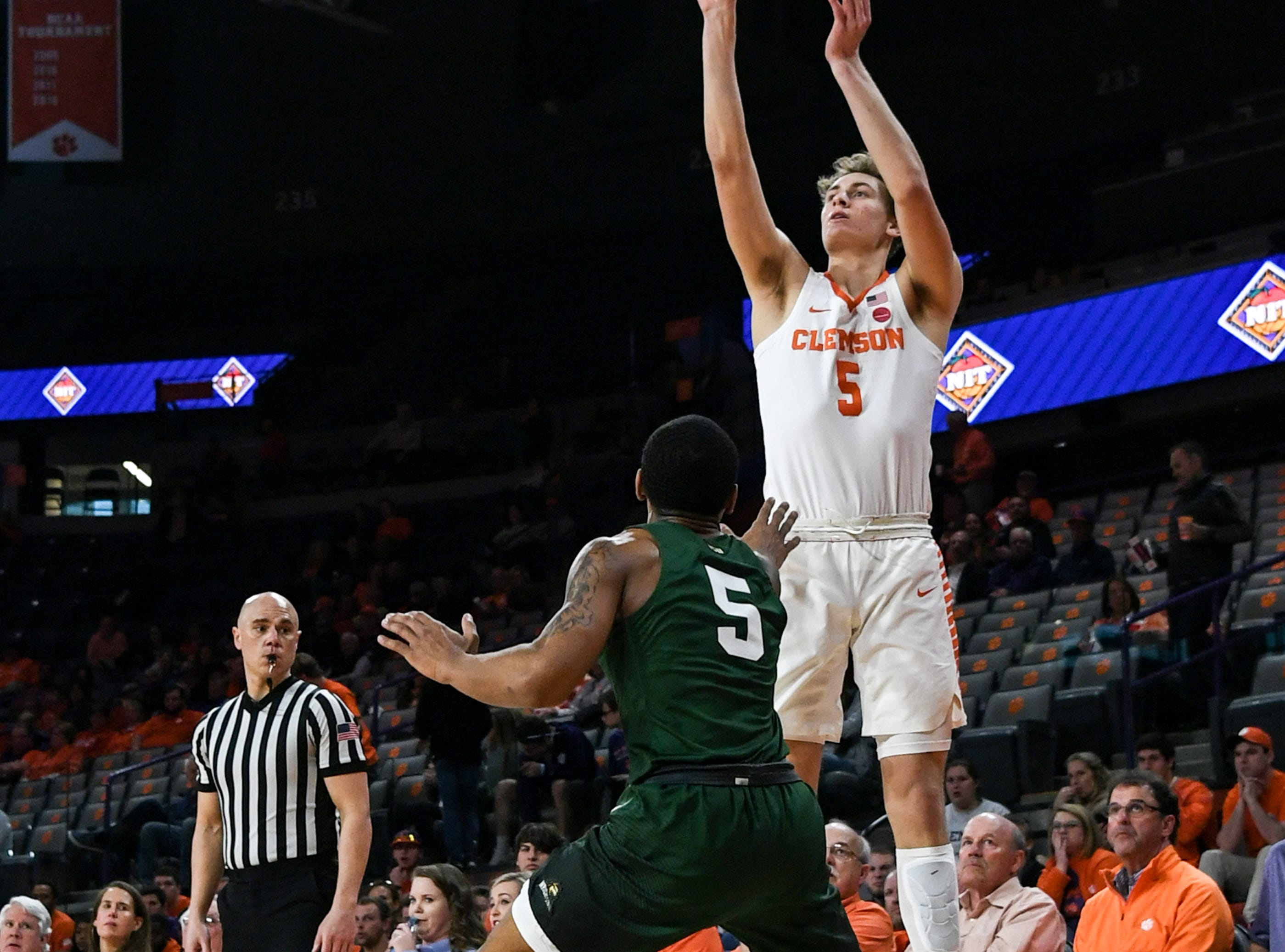 Clemson forward Hunter Tyson(5) shoots a three-pointer near Wright State guard Skyelar Potter(5) during the first half of the NIT at Littlejohn Coliseum in Clemson Tuesday, March 19, 2019.
