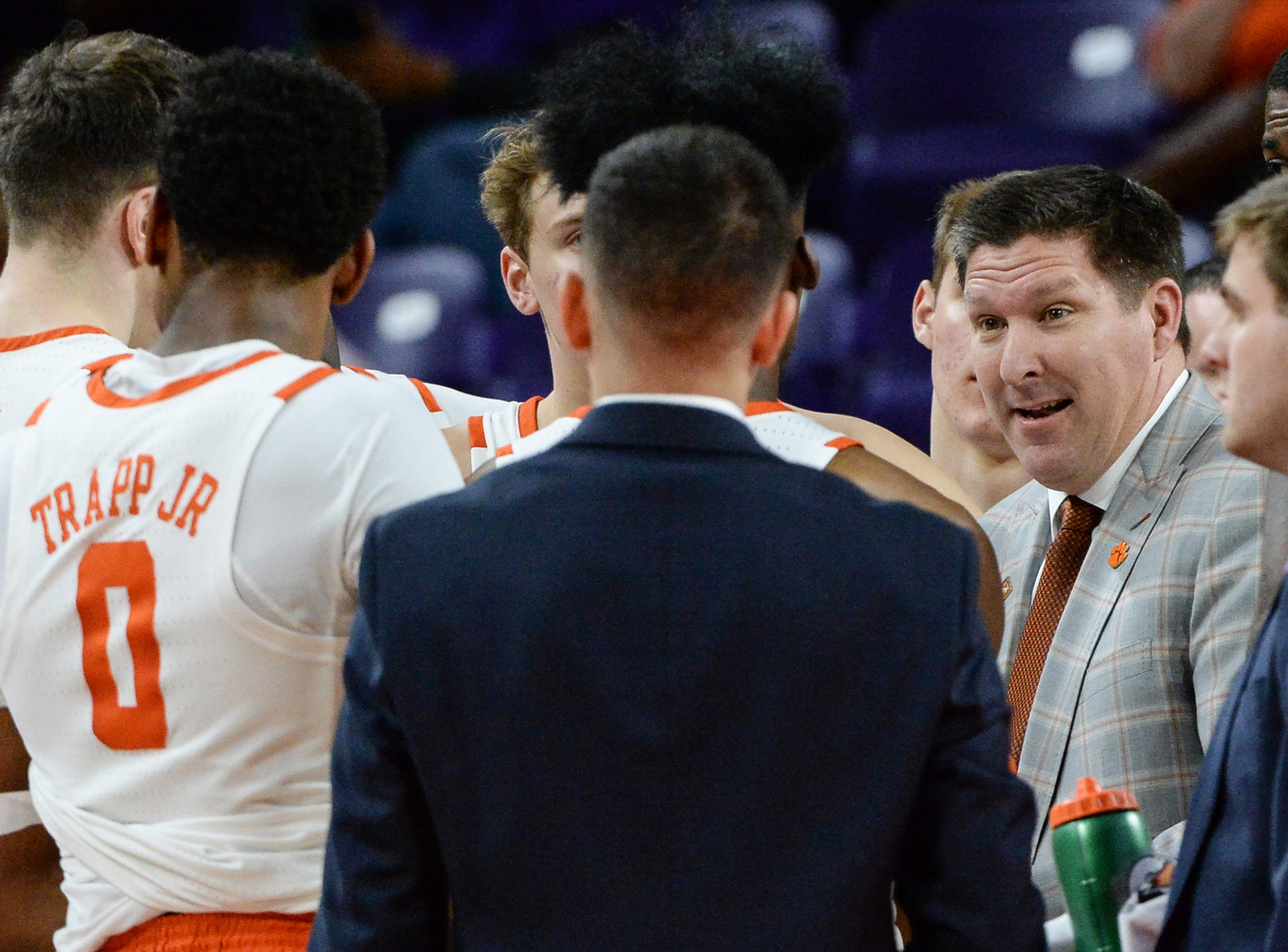 Clemson head coach Brad Brownell talks with player during the first half of the NIT at Littlejohn Coliseum in Clemson Tuesday, March 19, 2019.