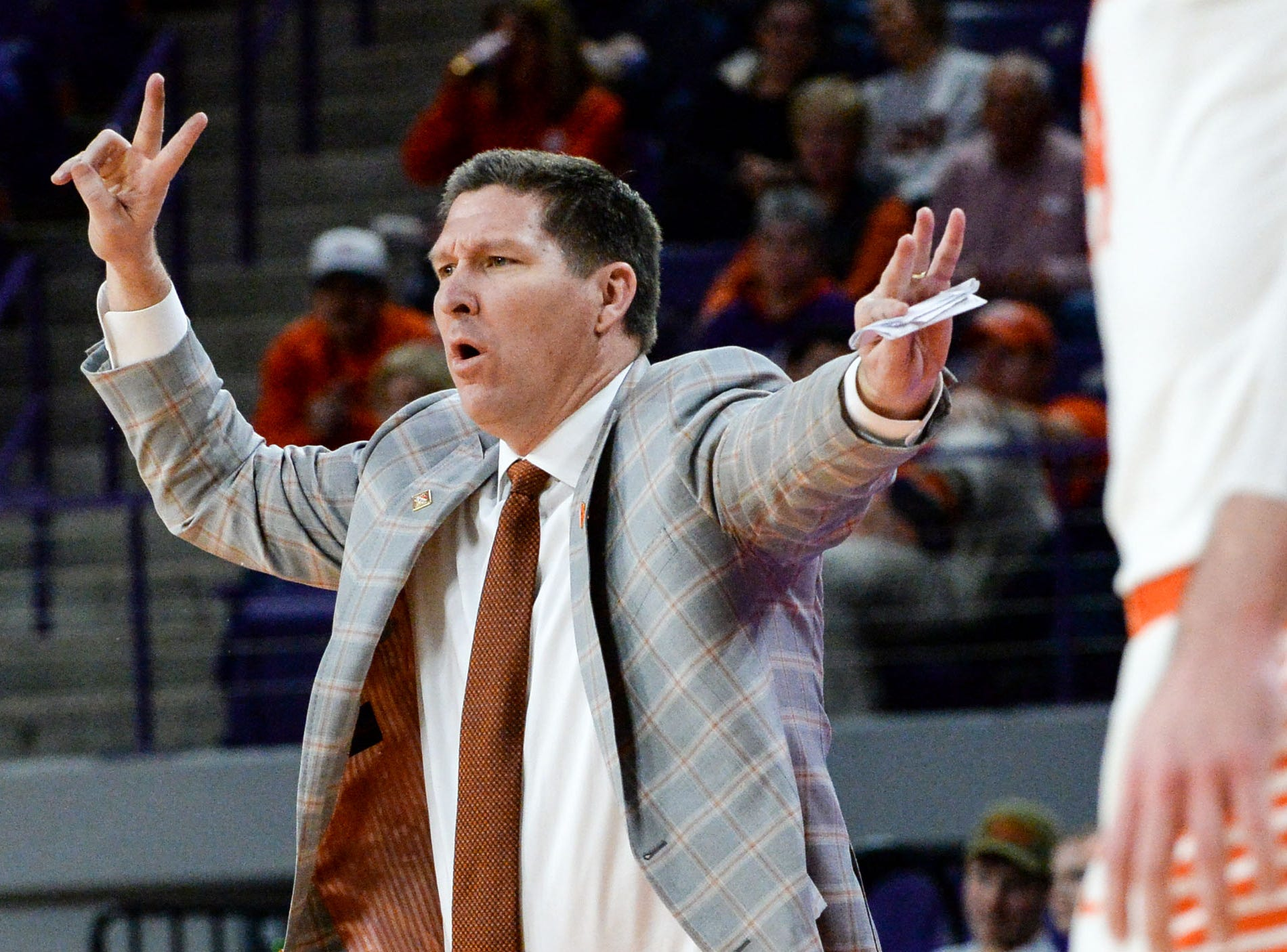 Clemson head coach Brad Brownell communicates with players in the Wright State game during the second half of the NIT at Littlejohn Coliseum in Clemson Tuesday, March 19, 2019.