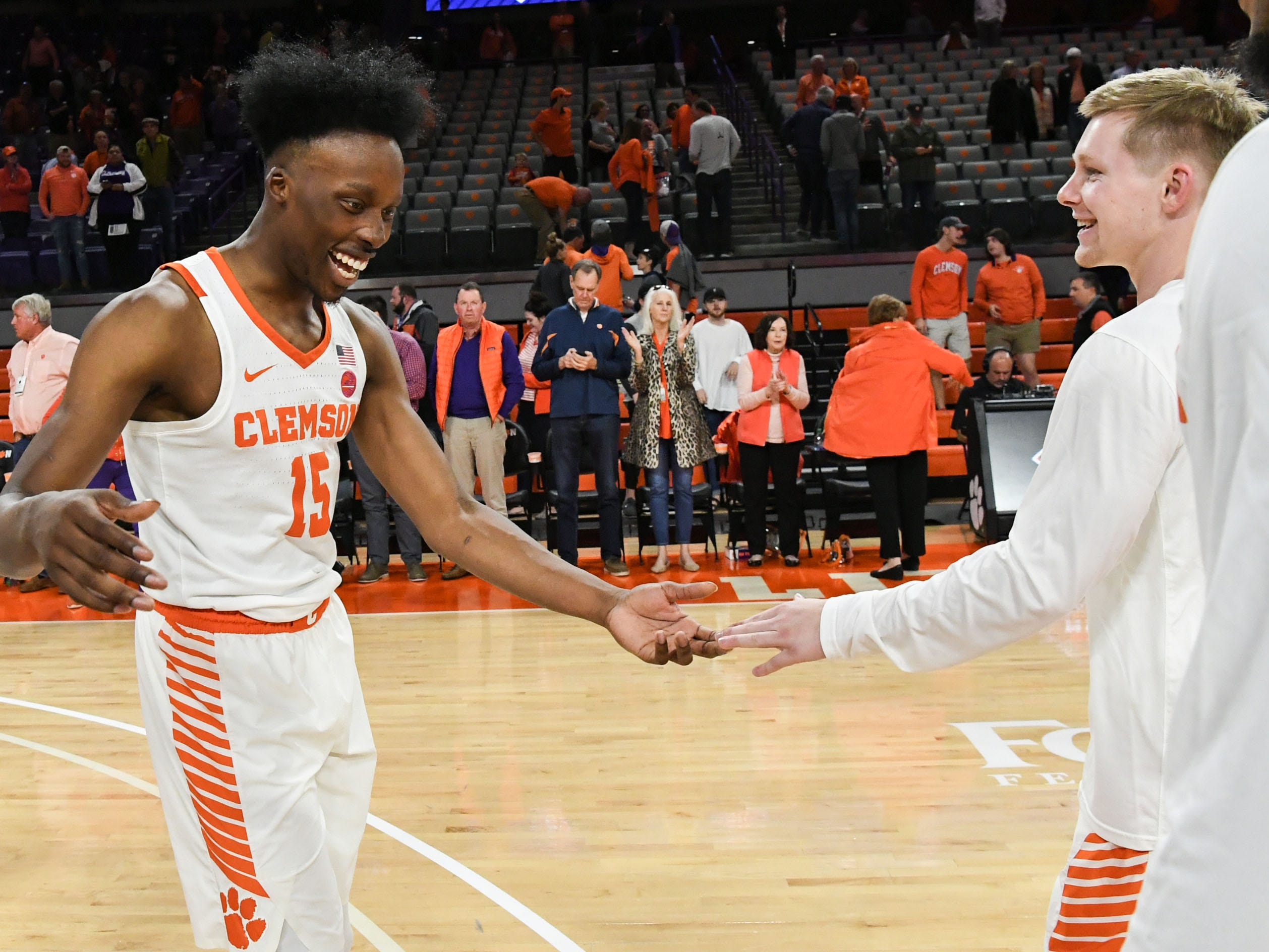Clemson forward John Newman (15) and Clemson guard Lyles Davis (3) celebrate after the Tigers beat Wright State 75-69 in the first round of the NIT at Littlejohn Coliseum in Clemson Tuesday, March 19, 2019.