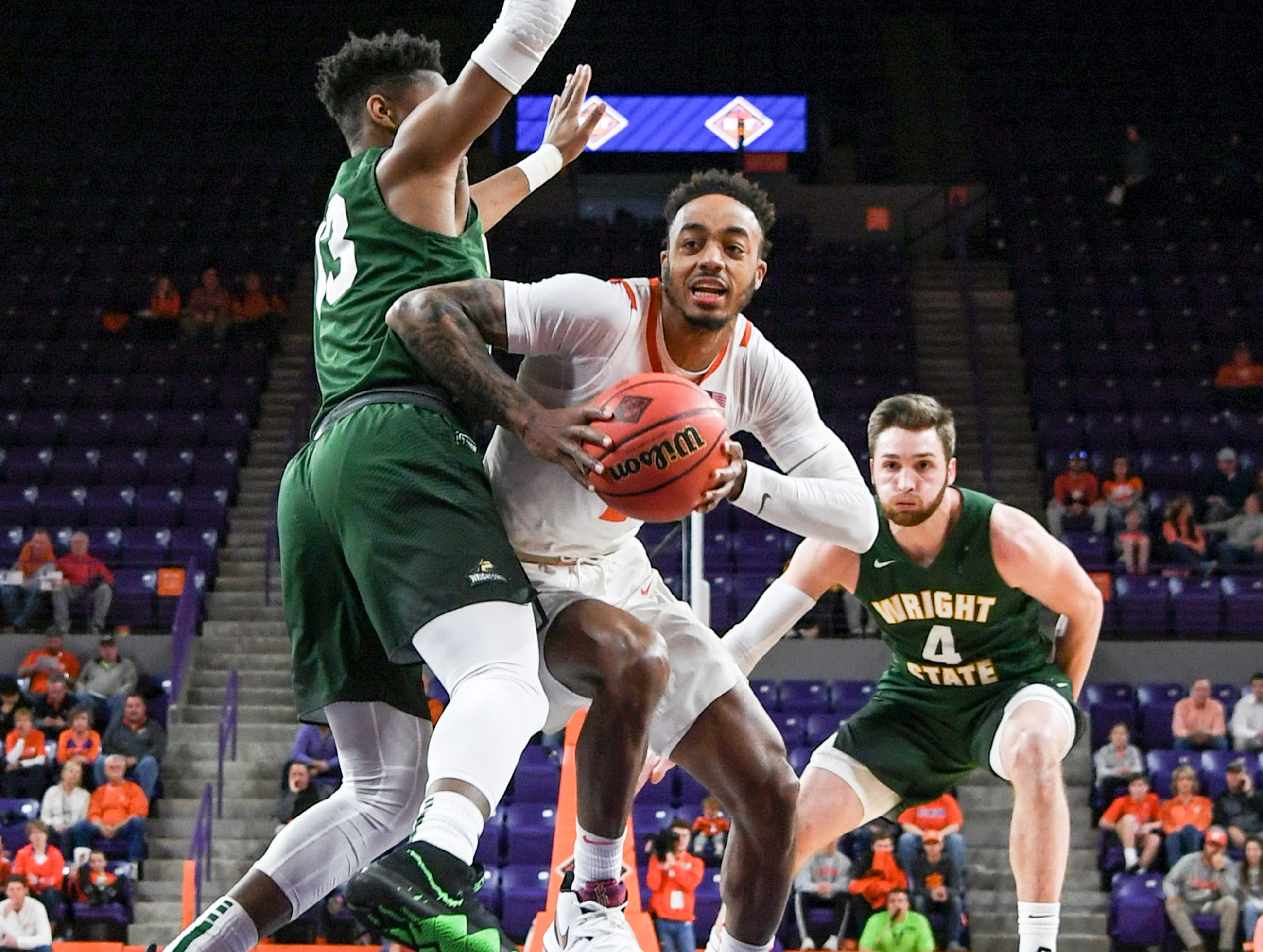 Clemson guard Marcquise Reed (2) dribbles near Wright State guard Alan Vest(4) during the first half of the NIT at Littlejohn Coliseum in Clemson Tuesday, March 19, 2019.