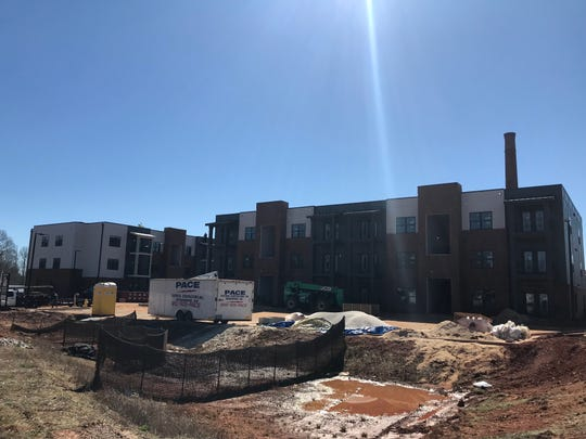 Construction continues on the Cotton Mill apartments on South Street in Simpsonville on March 6, 2019.