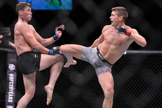 "Simpsonville UFC fighter Stephen ""Wonderboy"" Thompson battles Darren Till during their fight on May 27, 2018, in Liverpool, United Kingdom."