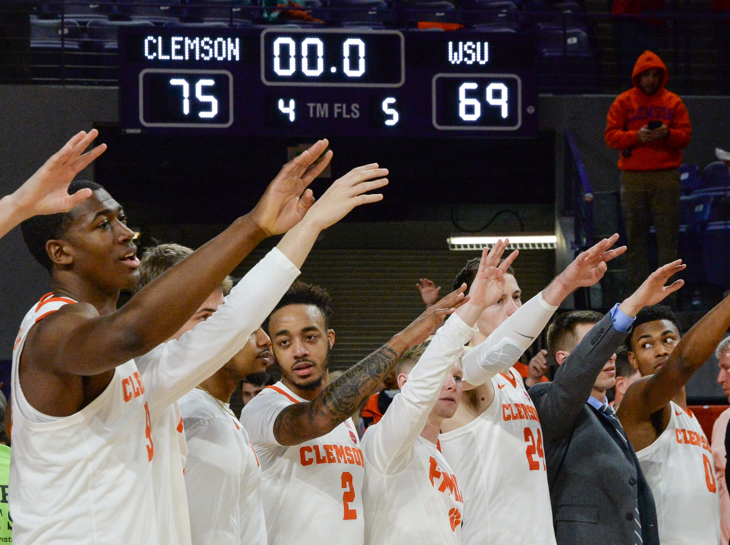 Clemson players celebrate during the second half of the NIT at Littlejohn Coliseum in Clemson Tuesday, March 19, 2019.