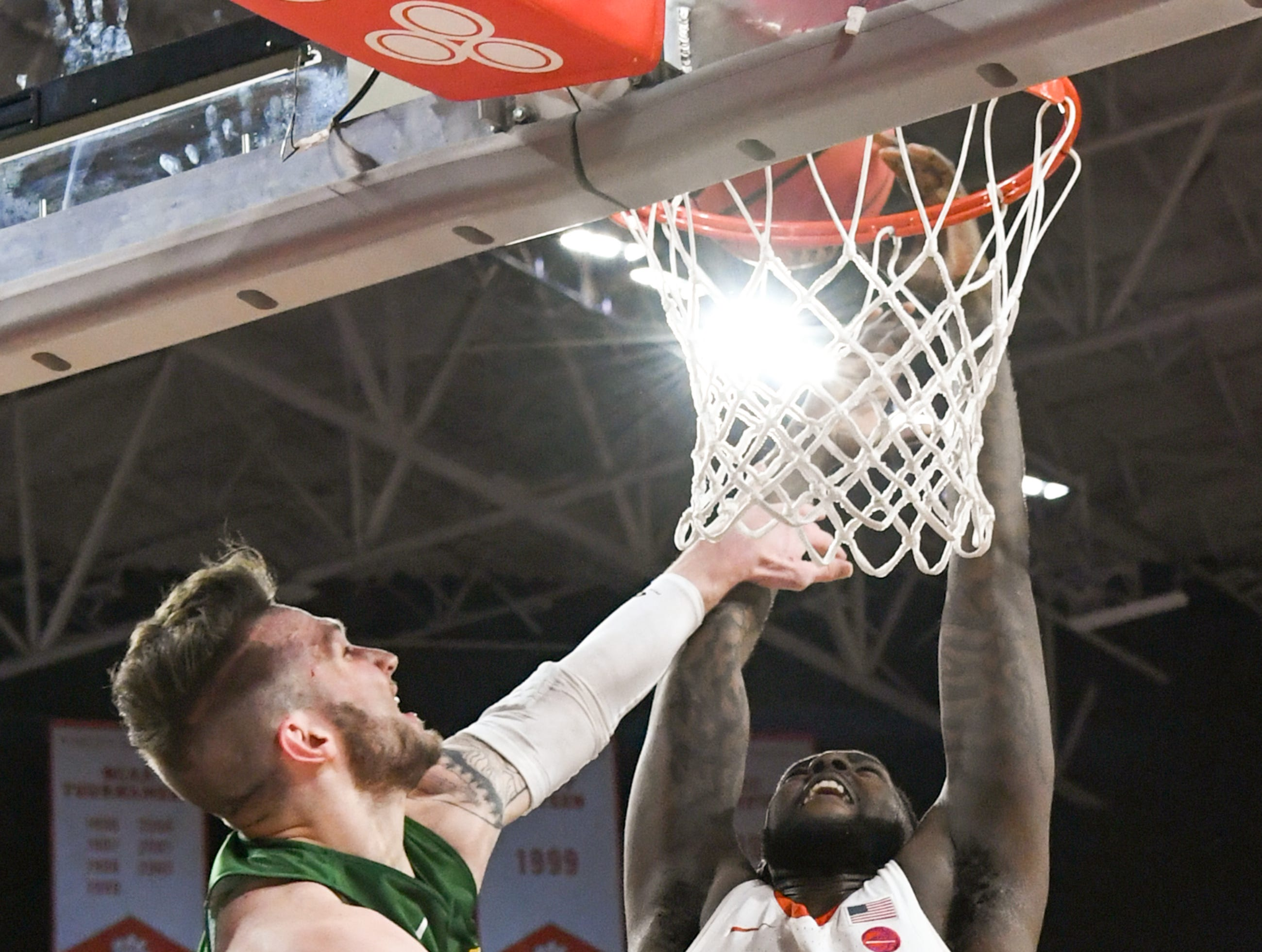 Clemson forward Elijah Thomas (14) attempts to dunk near Wright State guard Alan Vest(4) during the second half of the NIT at Littlejohn Coliseum in Clemson Tuesday, March 19, 2019.