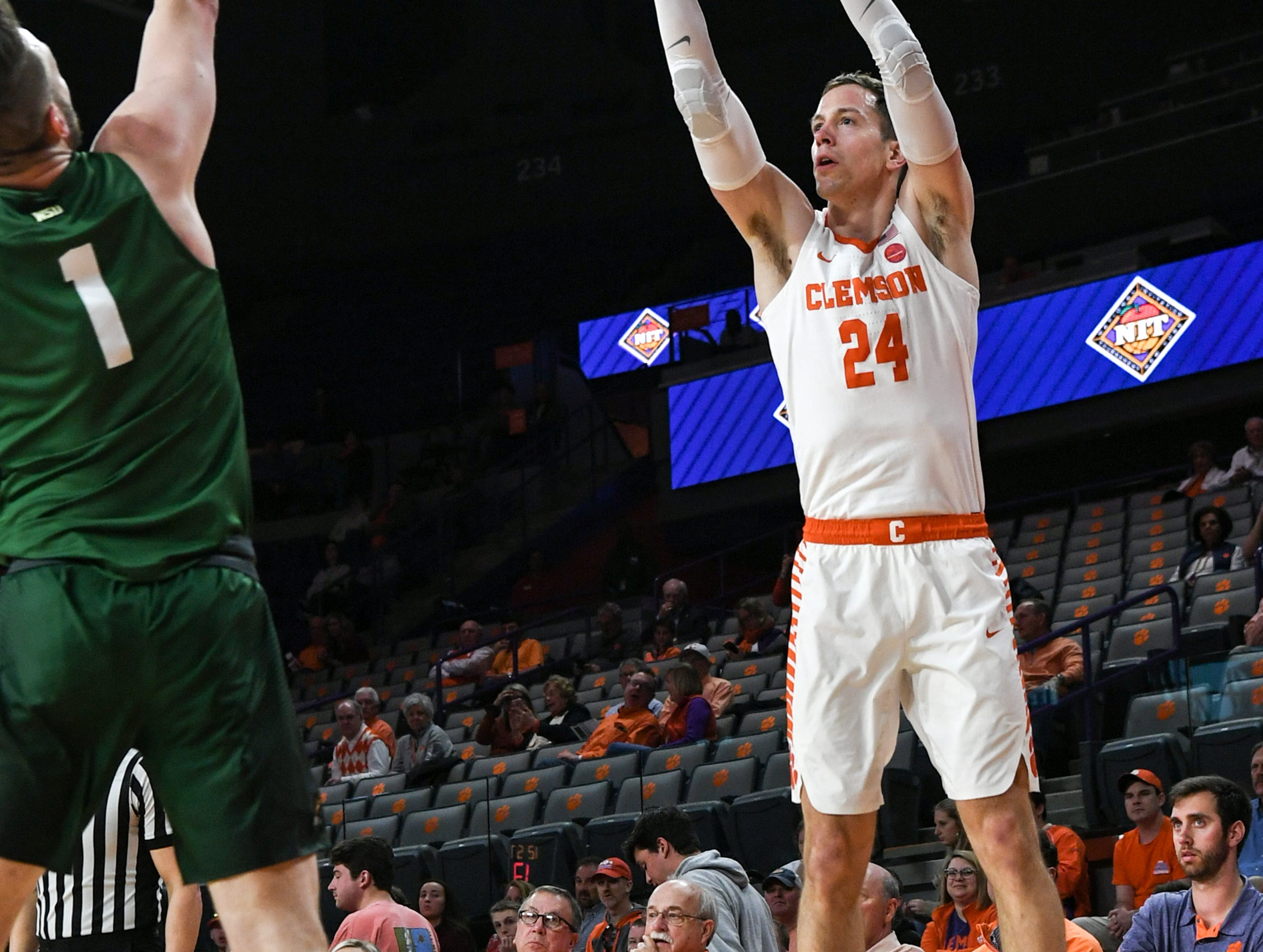 Clemson forward David Skara (24) shoots a three-pointer near Wright State forward Bill Wampler(1) during the first half of the NIT at Littlejohn Coliseum in Clemson Tuesday, March 19, 2019.