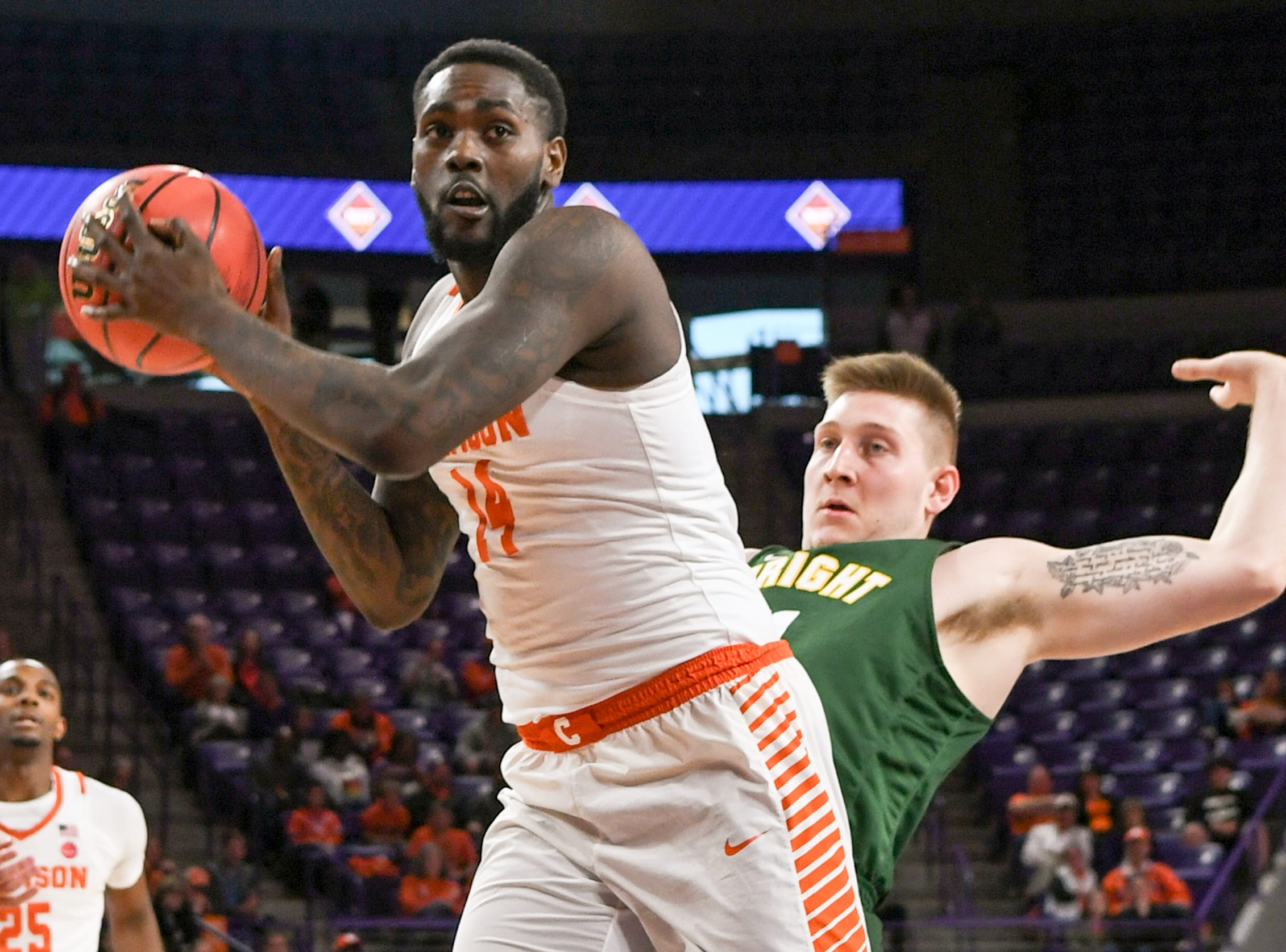 Clemson forward Elijah Thomas (14) rebounds near Wright State center Loudon Love(11) during the first half of the NIT at Littlejohn Coliseum in Clemson Tuesday, March 19, 2019.
