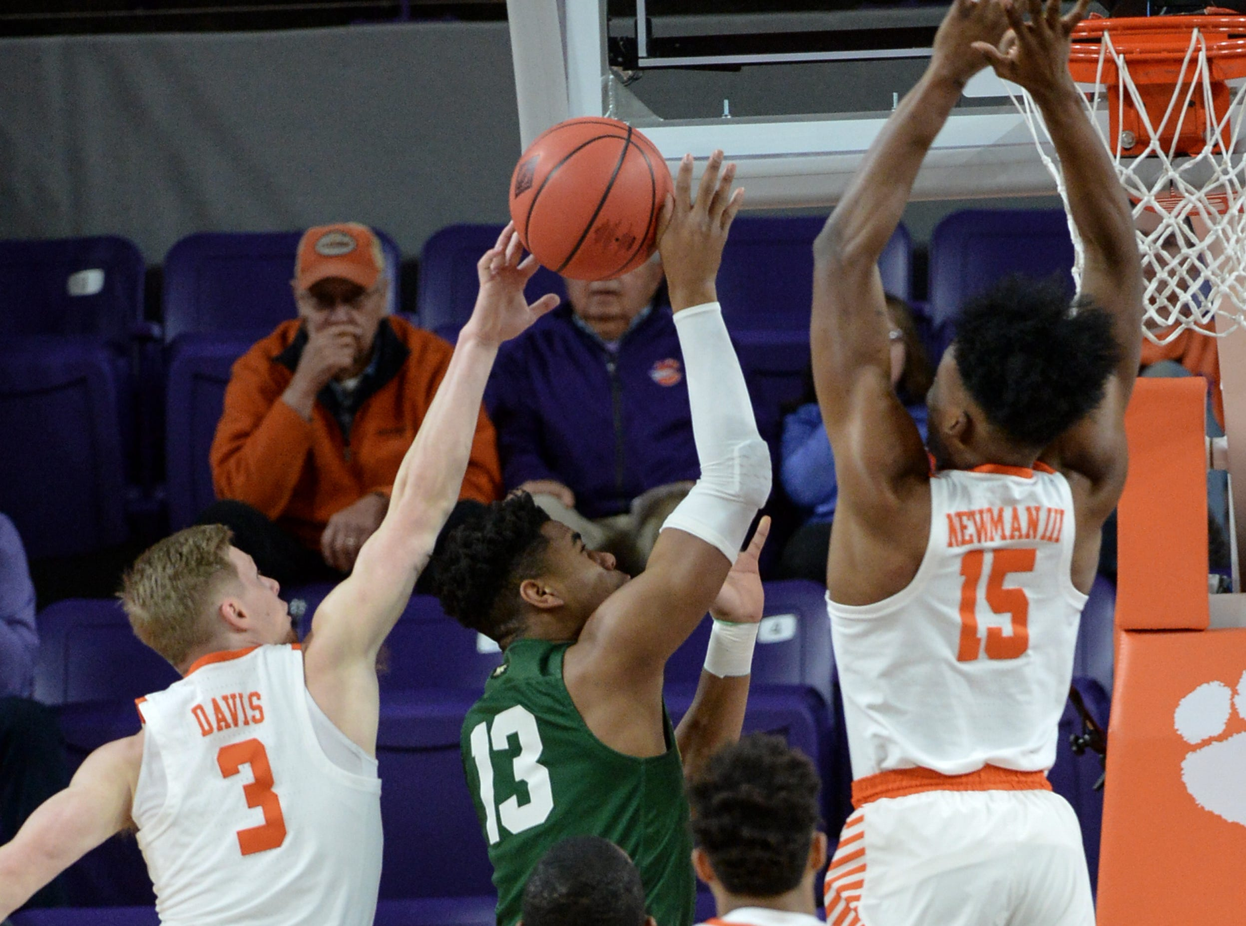 Clemson guard Lyles Davis (3) blocks the shot of Wright State guard Malachi Smith(13) near Clemson forward John Newman (15) during the first half of the NIT at Littlejohn Coliseum in Clemson Tuesday, March 19, 2019.
