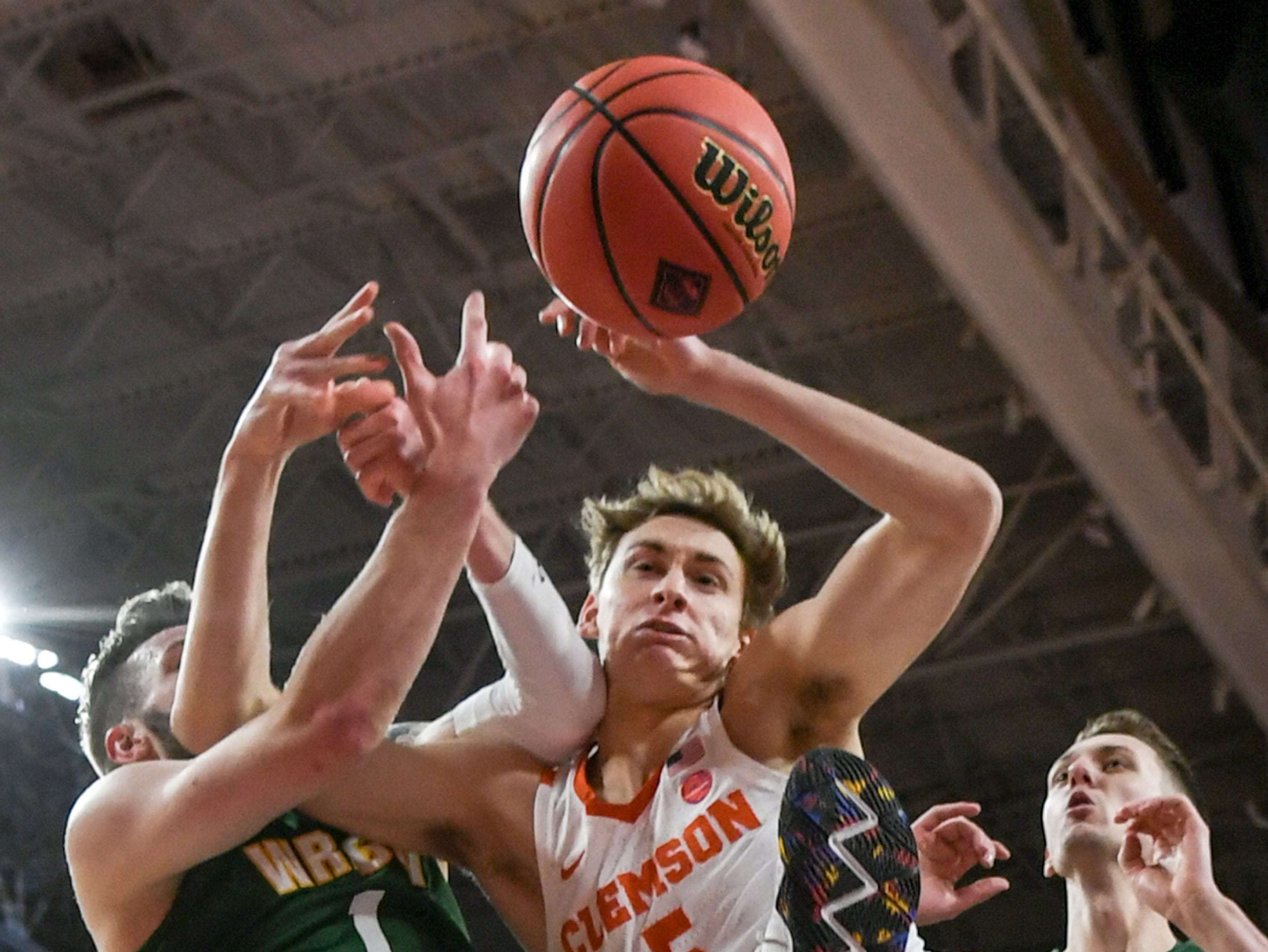 Clemson forward Hunter Tyson(5) and Wright State forward Bill Wampler(1) get tangled over a loose ball during the first half of the NIT at Littlejohn Coliseum in Clemson Tuesday, March 19, 2019.