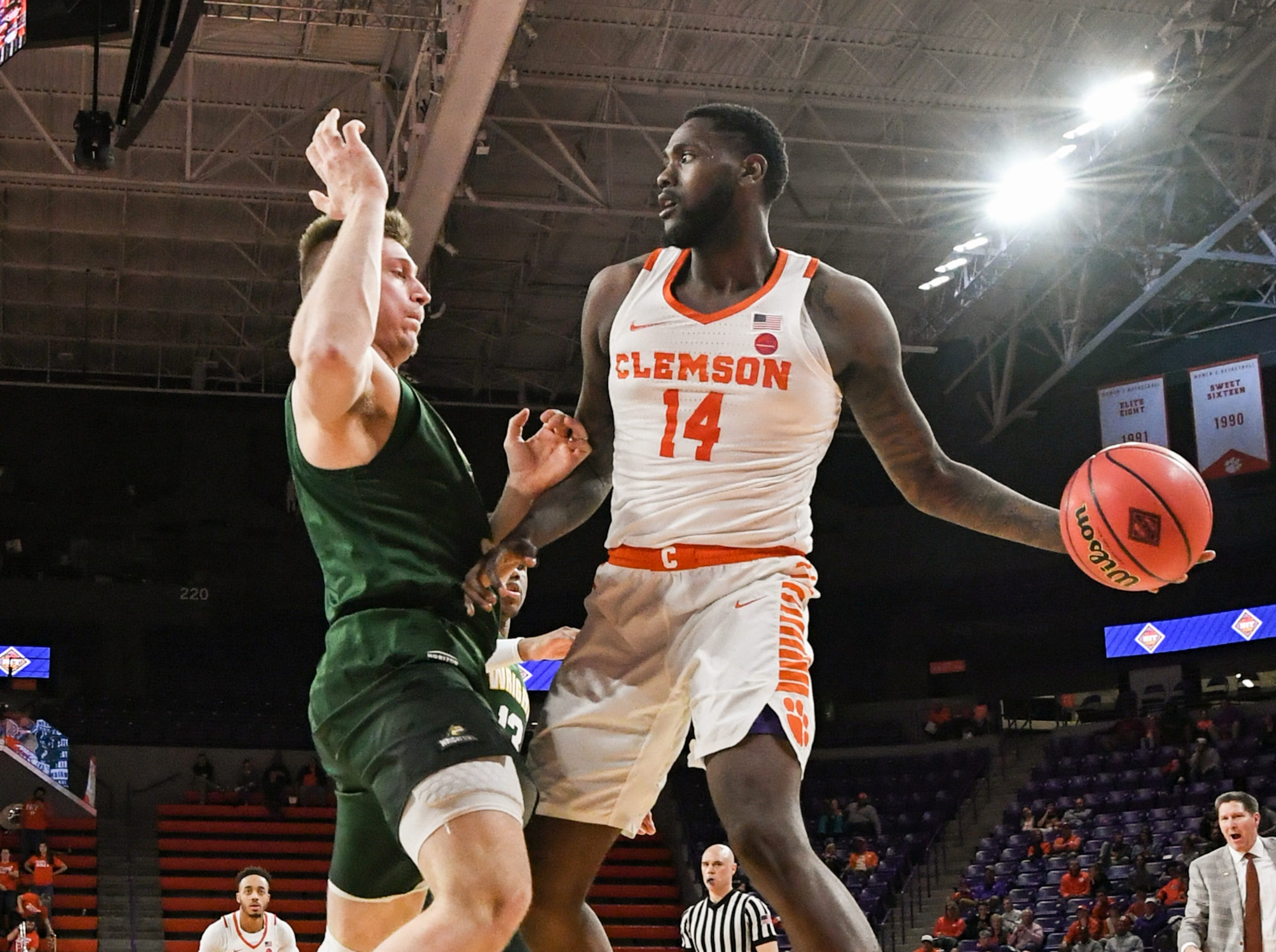 Clemson forward Elijah Thomas (14) looks to pass around Wright State center Parker Ernsthausen(22) during the second half of the NIT at Littlejohn Coliseum in Clemson Tuesday, March 19, 2019.