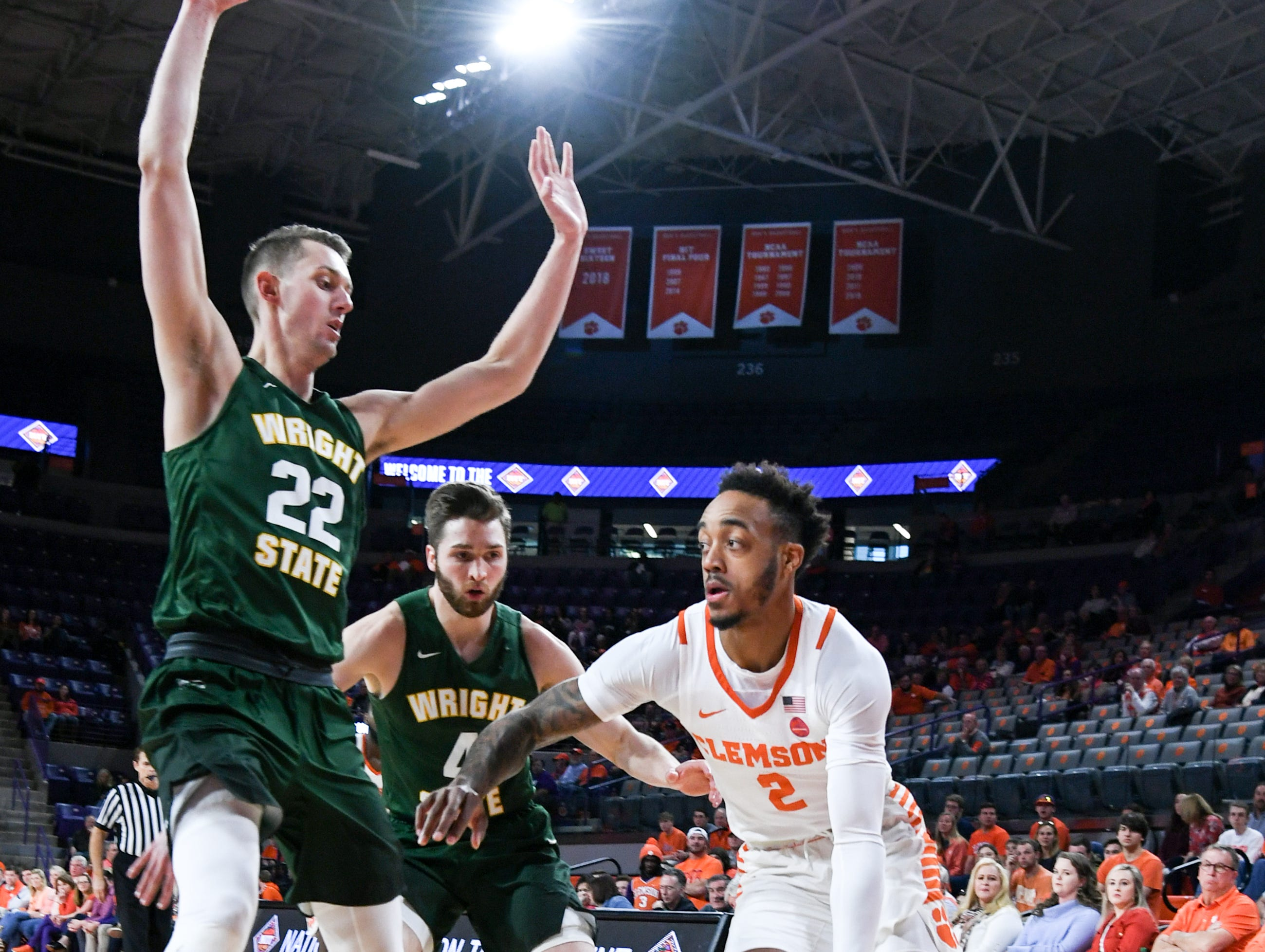 Clemson guard Marcquise Reed (2) dribbles near Wright State center Parker Ernsthausen(22) during the first half of the NIT at Littlejohn Coliseum in Clemson Tuesday, March 19, 2019.