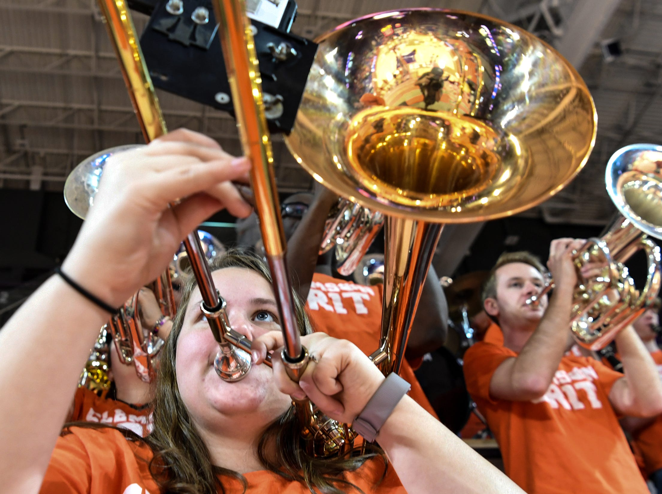 Jessie Blakely, a sophomore trombone player in the Tiger Band, plays during the first half of the NIT at Littlejohn Coliseum in Clemson Tuesday, March 19, 2019.