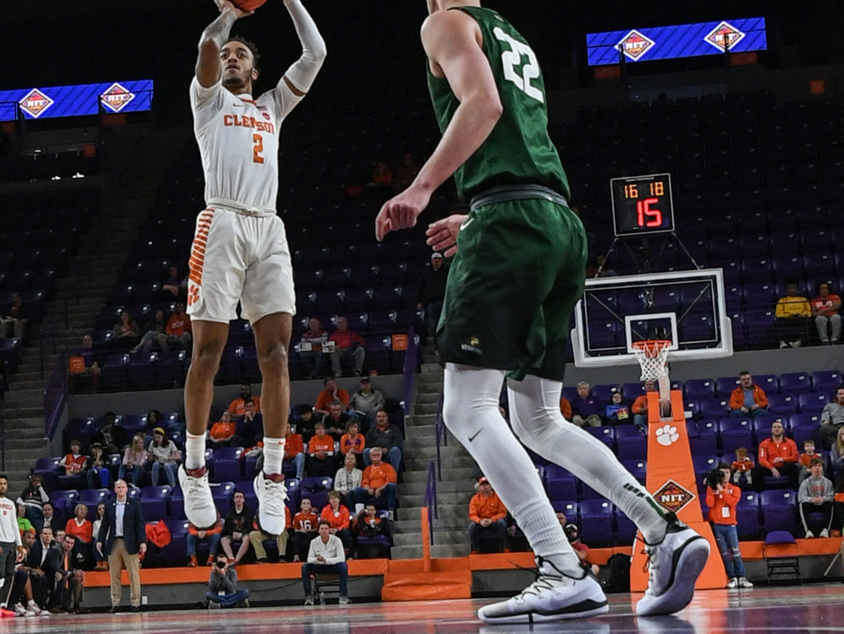 Clemson guard Marcquise Reed (2) shoots near Wright State center Parker Ernsthausen(22) during the first half of the NIT at Littlejohn Coliseum in Clemson Tuesday, March 19, 2019.