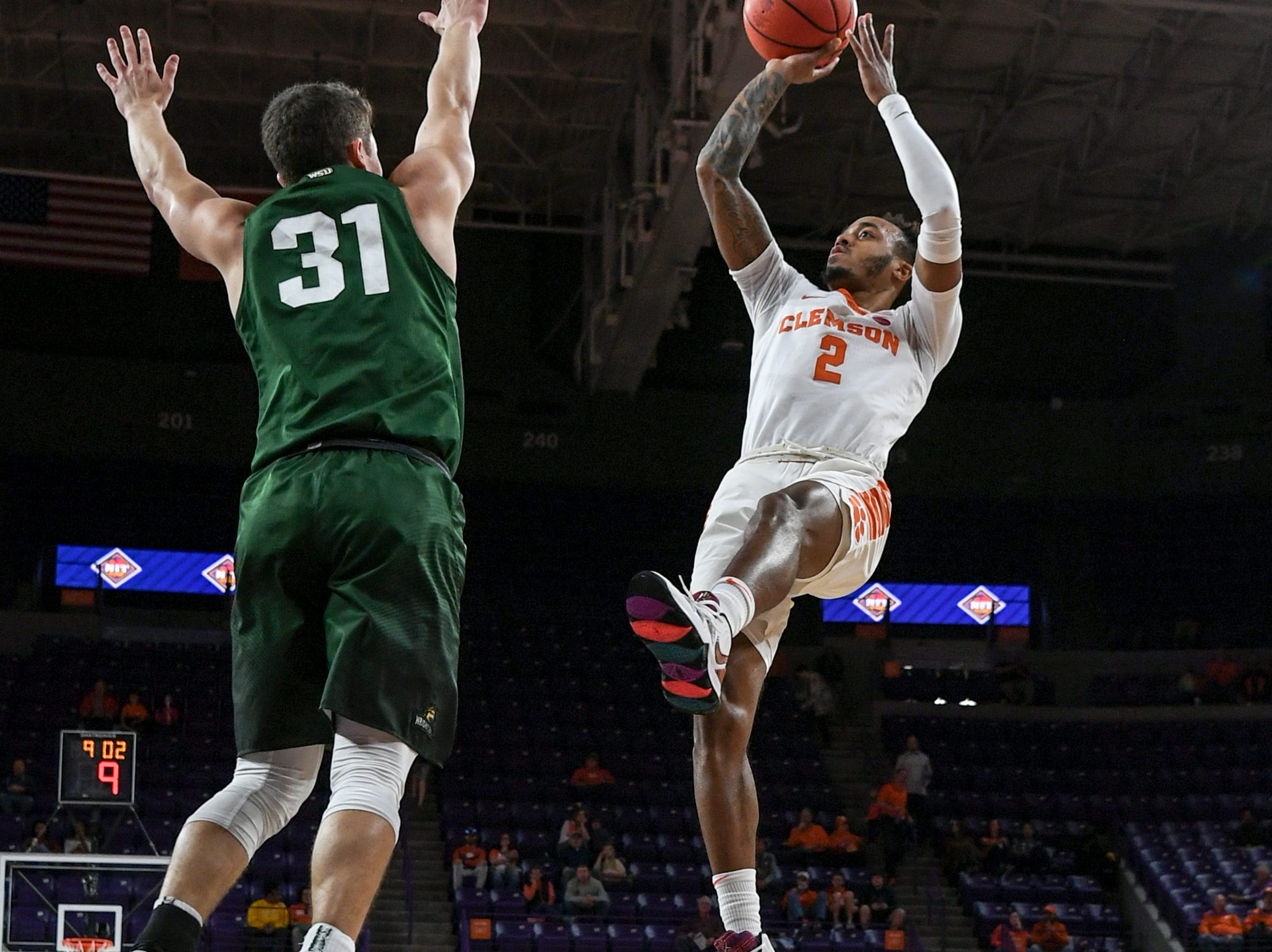 Clemson guard Marcquise Reed (2) shoots near Wright State guard Cole Gentry(31) during the first half of the NIT at Littlejohn Coliseum in Clemson Tuesday, March 19, 2019.