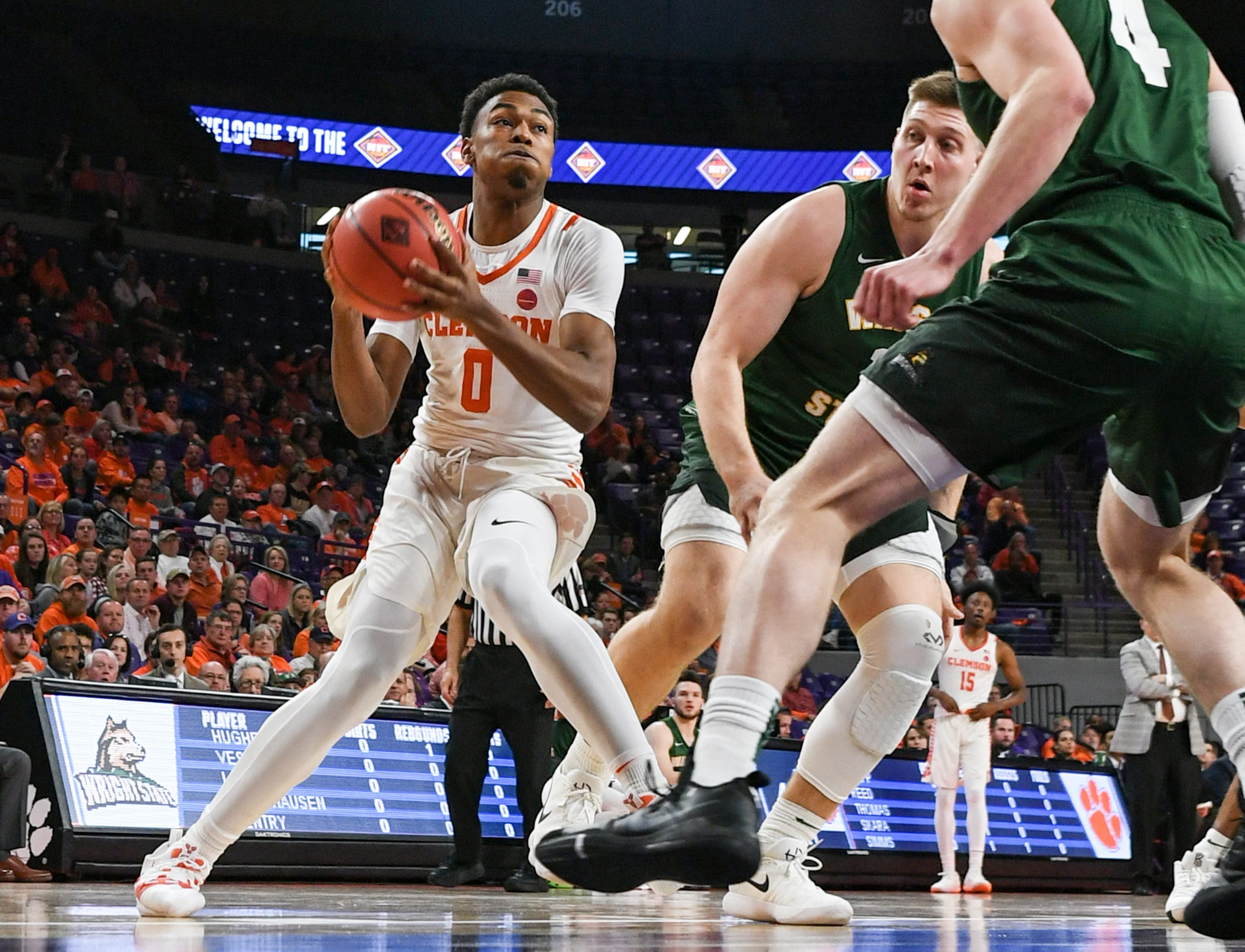 Clemson center Clyde Trapp (0) dribbles Wright State guard Alan Vest(4) during the first half of the NIT at Littlejohn Coliseum in Clemson Tuesday, March 19, 2019.