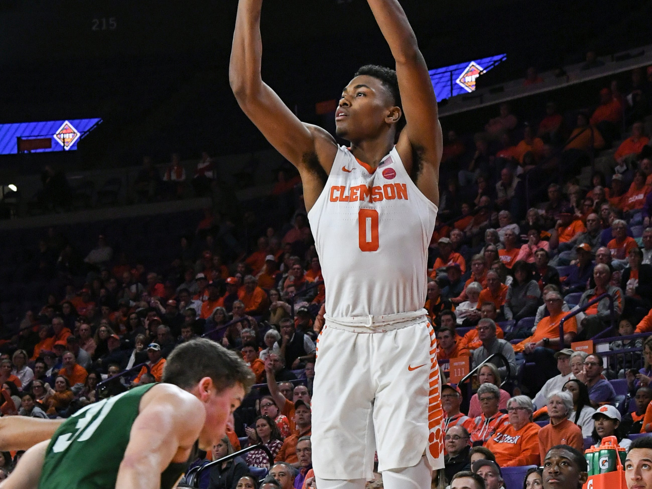 Clemson center Clyde Trapp (0) shoots near Wright State guard Cole Gentry(31) during the second half of the NIT at Littlejohn Coliseum in Clemson Tuesday, March 19, 2019.