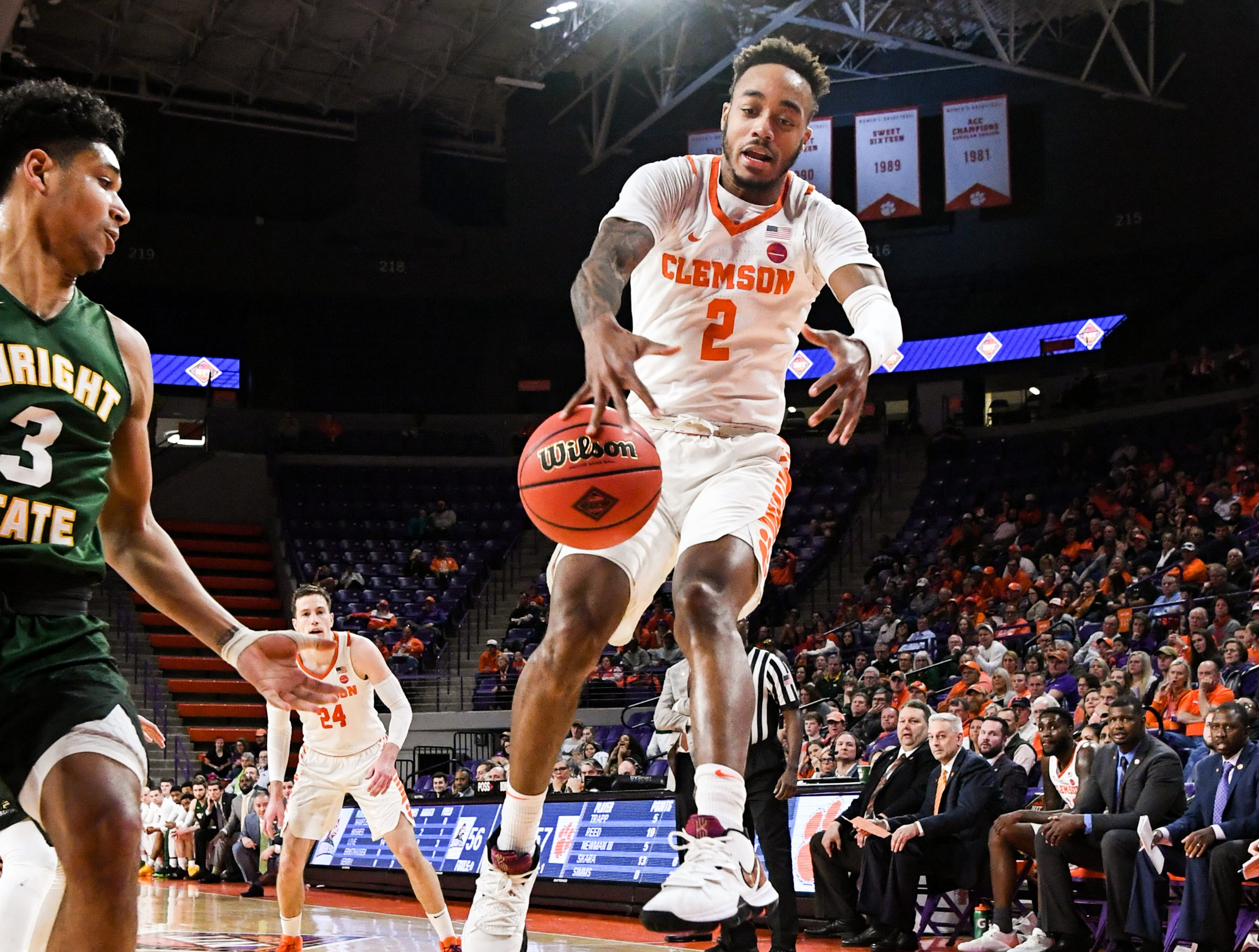 Clemson guard Marcquise Reed (2) reaches for a loose ball near Wright State guard Malachi Smith(13) during the second half of the NIT at Littlejohn Coliseum in Clemson Tuesday, March 19, 2019.