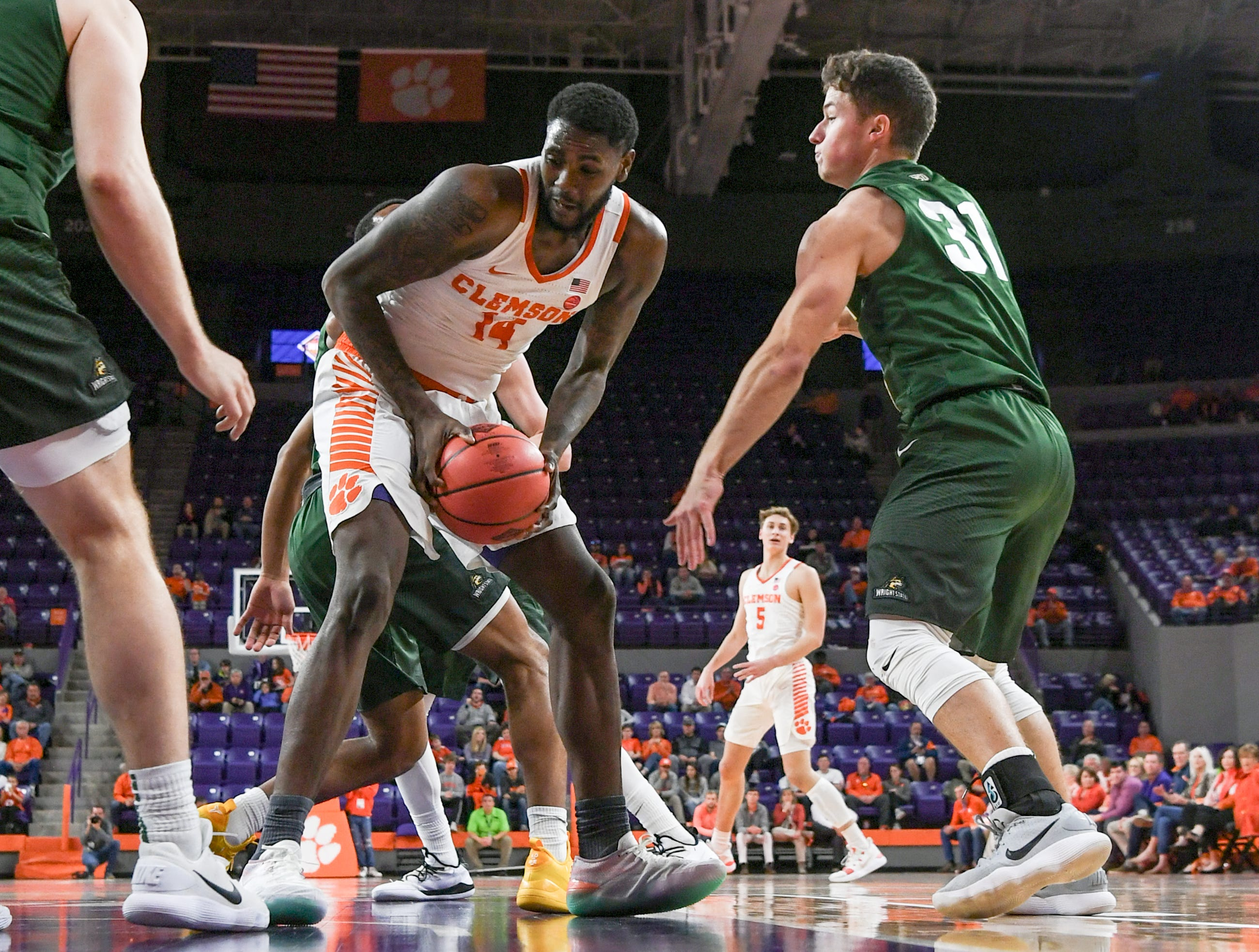 Clemson forward Elijah Thomas (14) rebounds near Wright State guard Cole Gentry(31) during the first half of the NIT at Littlejohn Coliseum in Clemson Tuesday, March 19, 2019.