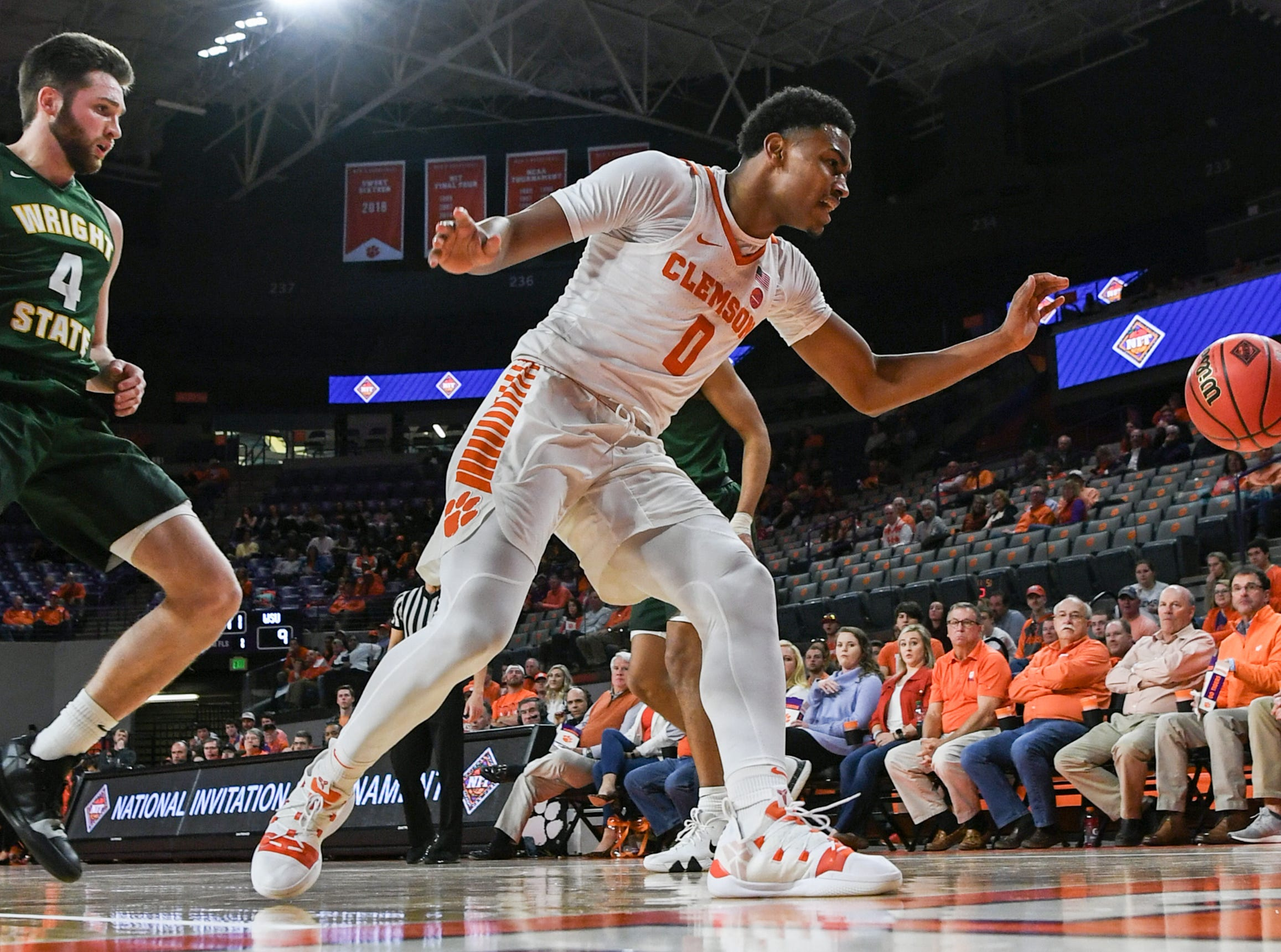 Clemson center Clyde Trapp (0) reaches for a loose ball near Wright State guard Alan Vest(4) during the first half of the NIT at Littlejohn Coliseum in Clemson Tuesday, March 19, 2019.