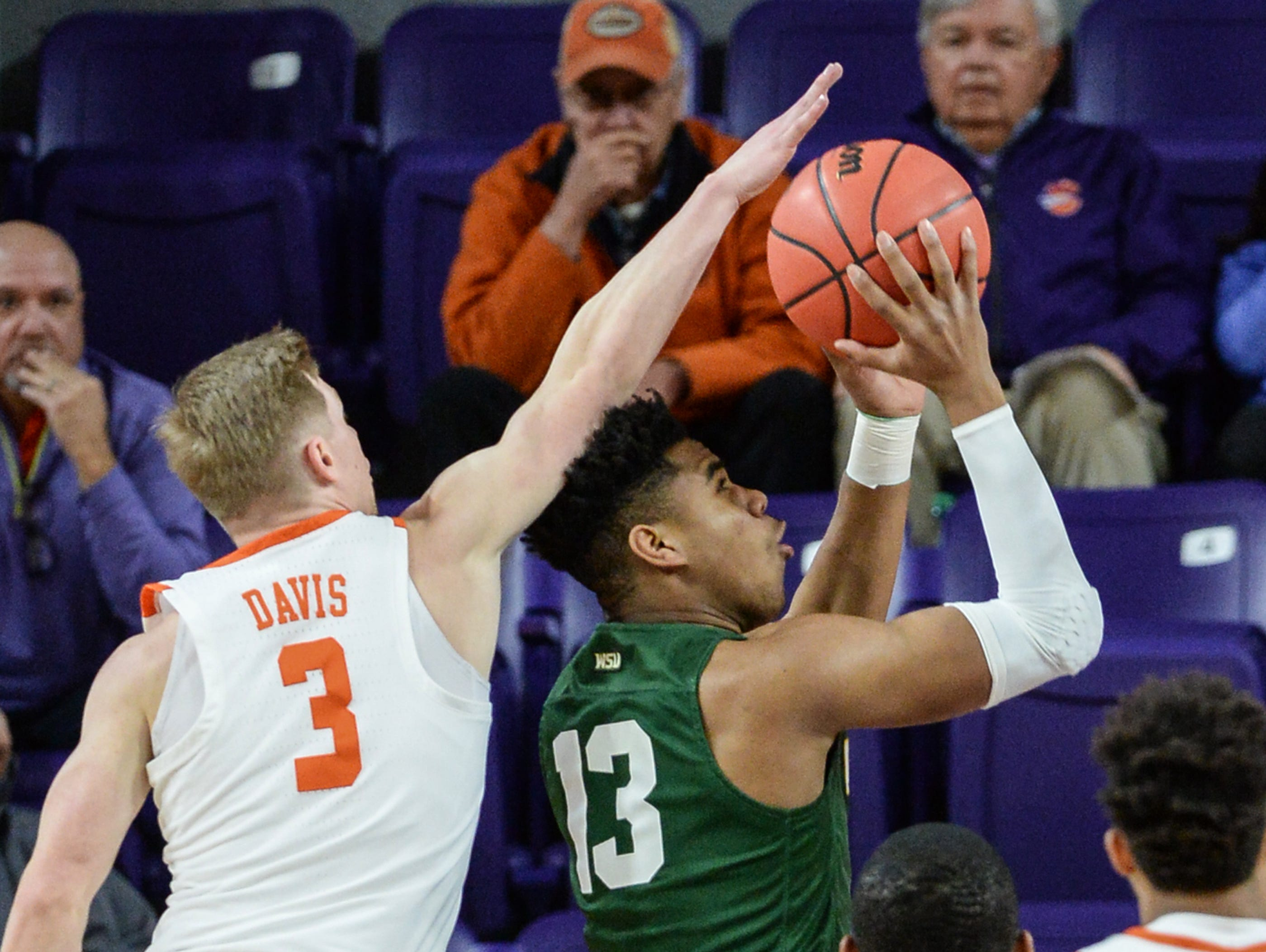 Clemson guard Lyles Davis (3) blocks a shot of Wright State guard Malachi Smith(13) during the first half of the NIT at Littlejohn Coliseum in Clemson Tuesday, March 19, 2019.