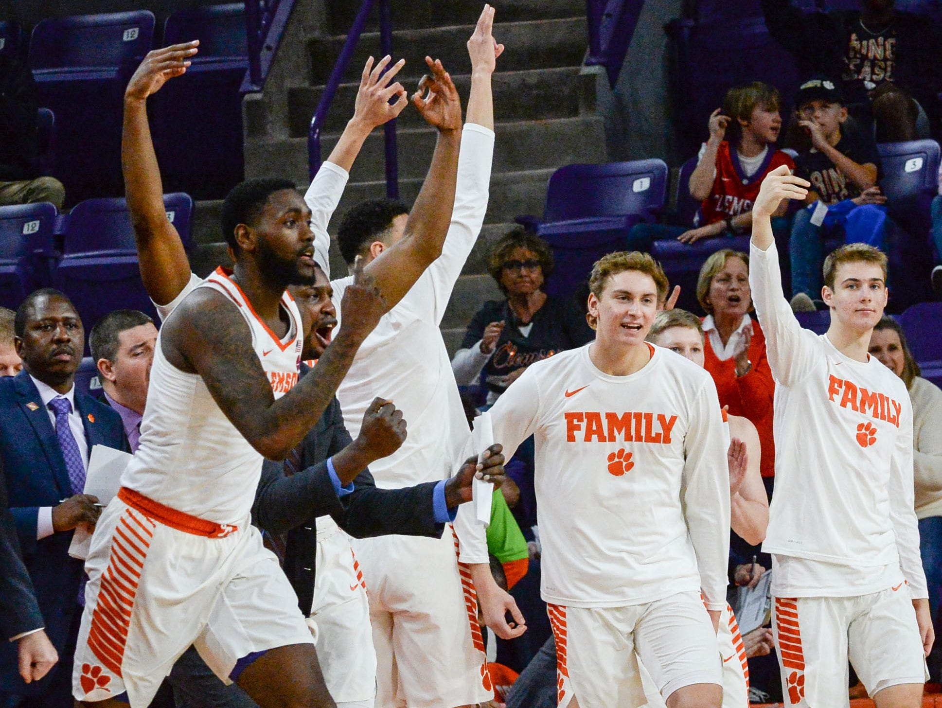 Clemson forward Elijah Thomas (14), left, and teammates celebrate a score against Wright State during the second half of the NIT at Littlejohn Coliseum in Clemson Tuesday, March 19, 2019.