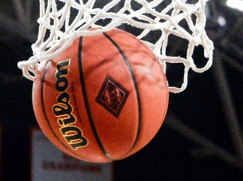 A NIT marked ball goes through the net during the second half of the NIT at Littlejohn Coliseum in Clemson Tuesday, March 19, 2019.