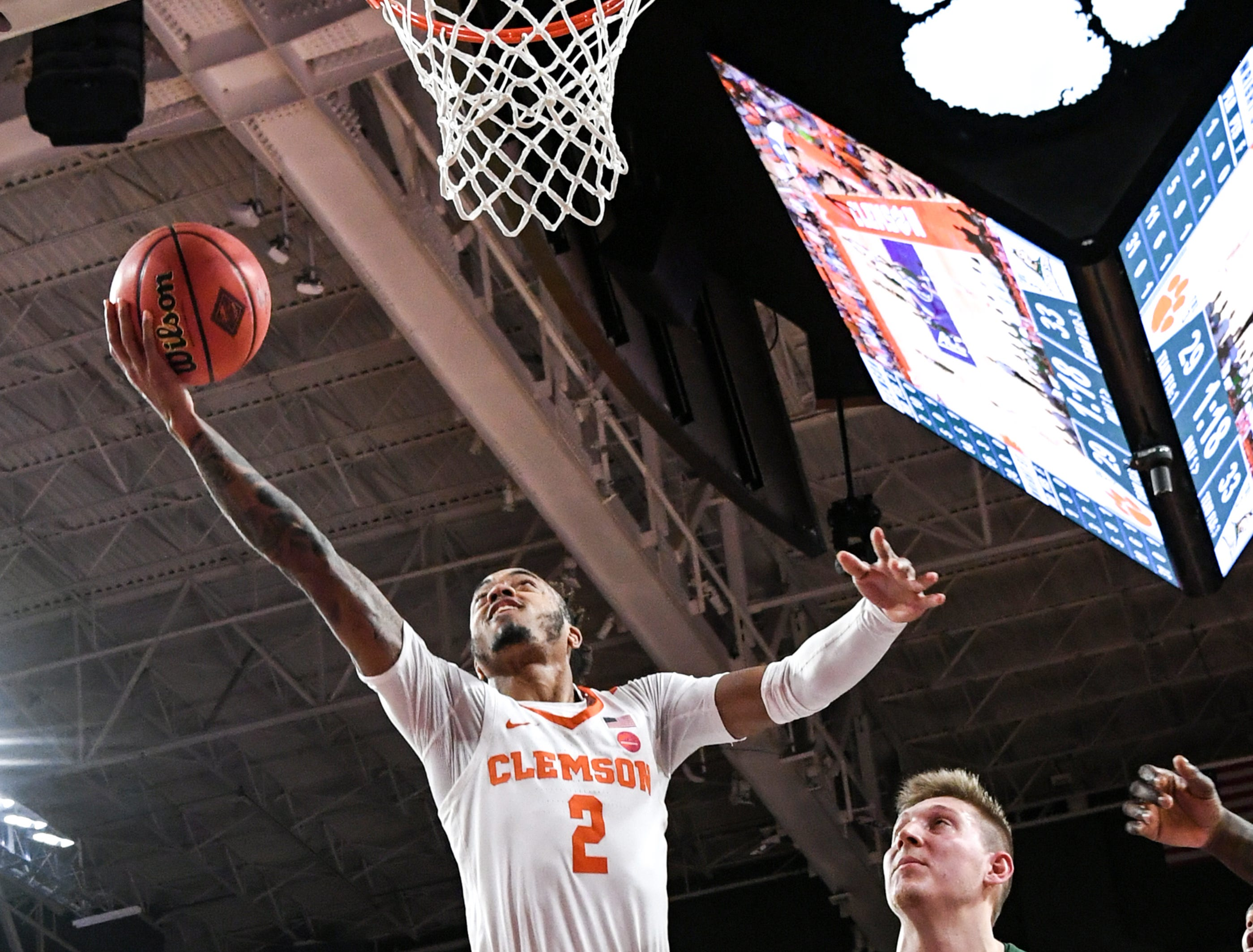 Clemson guard Marcquise Reed (2) shoots near Wright State center Loudon Love(11)