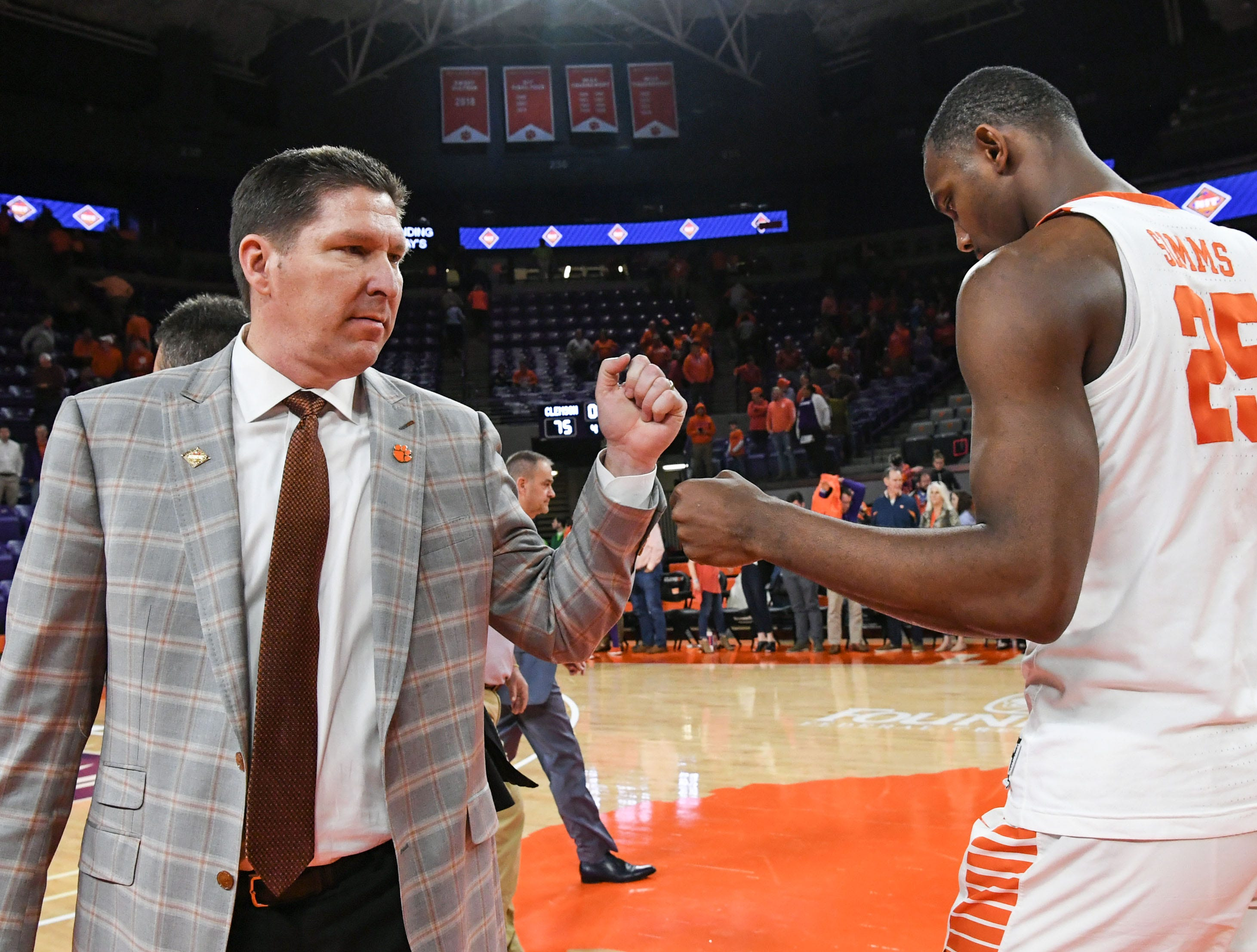 Clemson head coach Brad Brownell fist bumps Clemson forward Aamir Simms (25) after the Tigers beat Wright State 75-69 in the first round of the NIT at Littlejohn Coliseum in Clemson Tuesday, March 19, 2019.