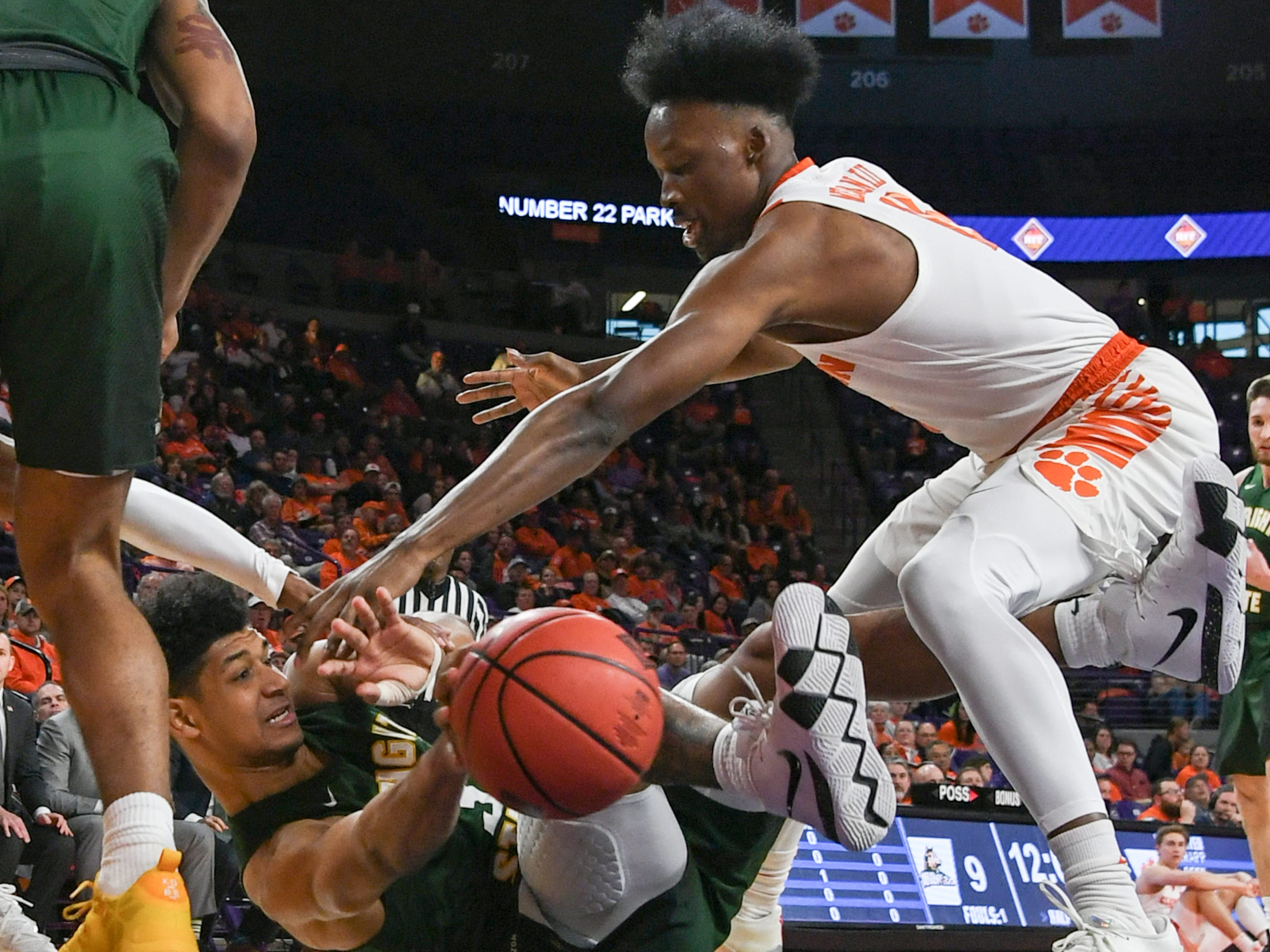 Wright State guard Malachi Smith(13) and Clemson forward John Newman (15) reach for a loose ball during the first half of the NIT at Littlejohn Coliseum in Clemson Tuesday, March 19, 2019.