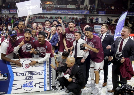Montana celebrates its 68-62 win over Eastern Washington in last Saturday's Big Sky Conference championship game.