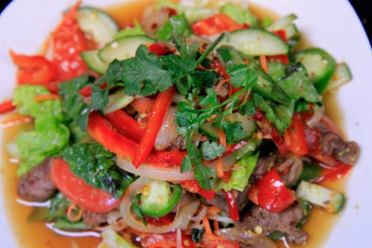 Thai beef salad is served cold with a light refreshing sauce to favor the dish.