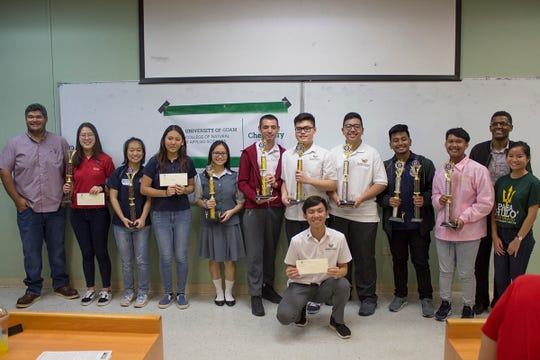 Twenty-four students from six high schools competed in the 2019 University of Guam High School Chemistry Titration Competition hosted by the Chemistry Program of UOG's College of Natural & Applied Sciences on March 12. The competition, held since 2009 on UOG's Charter Day, is an annual outreach event that tests students' skill and knowledge in the field of chemistry. From left: John Limtiaco, assistant professor, University of Guam; Soomin Lee, St. John's School; Angela Zhang and Sandra Han of Harvest Christian Academy; Maria Gloton of Academy of Our Lady of Guam; Clayton Brooks, Ron Coloma, and Jacob San Nicolas of Father Duenas Memorial School; Jacob Encio and Michael Gumataotao of Okkodo High School; Tedros Bezabeh, associate professor of chemistry, UOG; and Karla Wang, laboratory supervisor, UOG; and (front) Junya Kanemitsu of Father Duenas Memorial School.