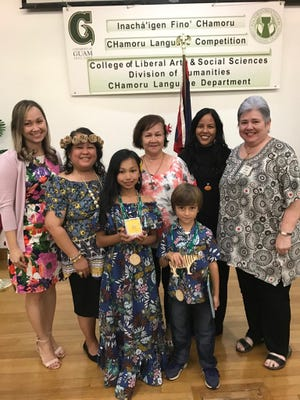 First place winners from the CHamoru storytelling competition held March 11 at the University of Guam.  Second to third grade category: Ina'tan Leon Guerrero Dunn and Fourth to fifth grade category: Sarai Dela Cruz. Pictured from left: Natasha Dela Cruz; Siñora LeVonne S. Mantanona; Sarai Dela Cruz; Saina Rufina F. Mendiola; Ina'tan Leon Guerrero Dunn; Siñora Loretta P Cruz; and Saina Laura M. Torres Souder.