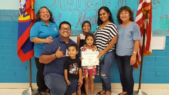 Guahan Academy Charter School February Student of the Month awardee on March 15. Pictured front row: T'Nel Mori; Odin Mori and Luna Mori. Back row from left: Mary Mafnas, Ryu and Dora Mori and Teresita Cruz.