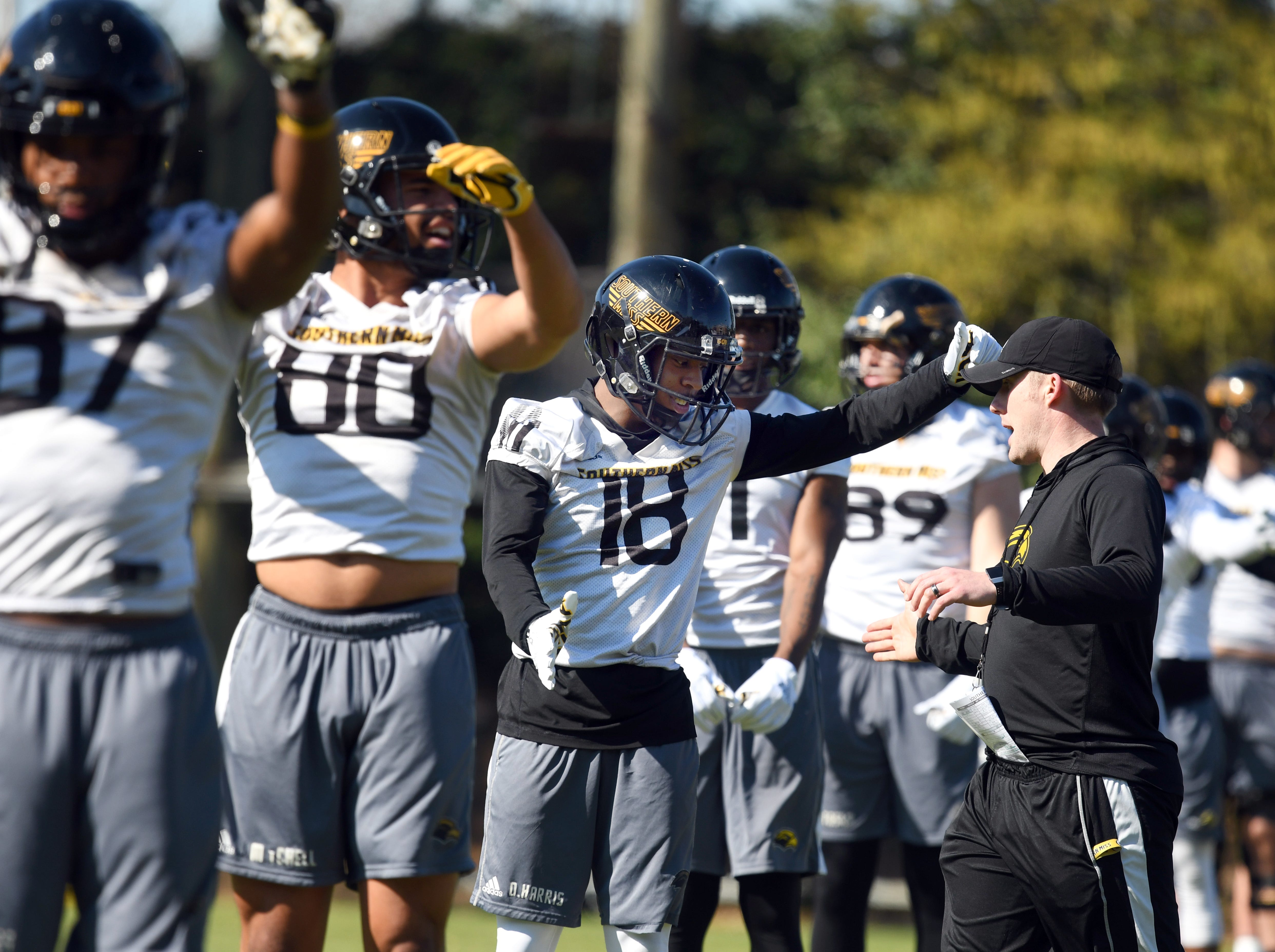 Southern Miss wide receivers coach Scotty Walden hypes up De'Michael Harris during the first day of spring practice in Hattiesburg on Tuesday, March 19, 2019.