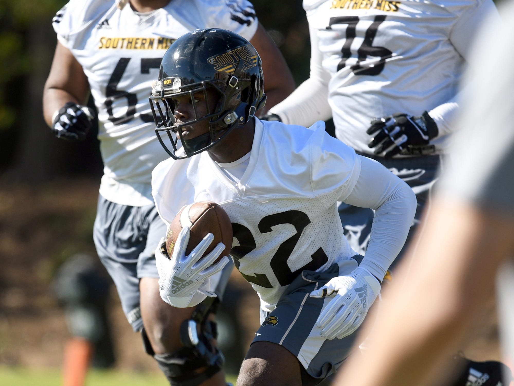 Southern Miss running back Trivenskey Mosley participates in the first day of spring practice in Hattiesburg on Tuesday, March 19, 2019.