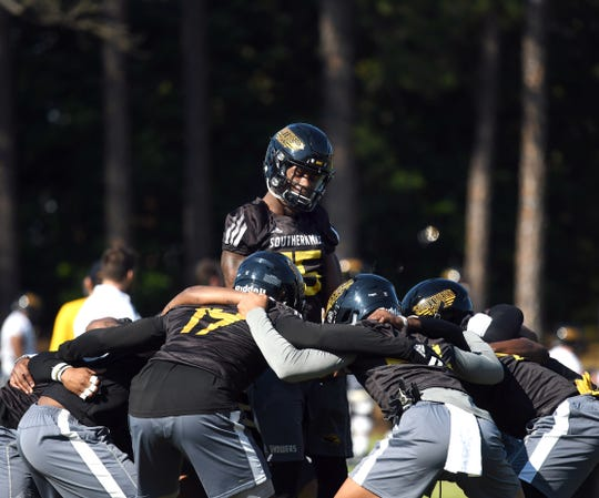 Southern Miss defensive back Shannon Showers hypes up his teammates during the first day of spring practice in Hattiesburg on Tuesday, March 19, 2019.
