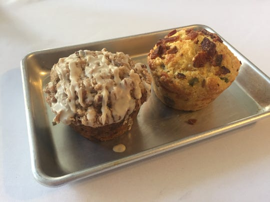 Roast Coffee Bar in Henderson will offer both sweet and savory muffins to go along with their coffees, teas and other beverages. Shown here are a Bacon Cheddar Corn Muffin, on right, and a frosted Banana Pecan Crumb Muffin.