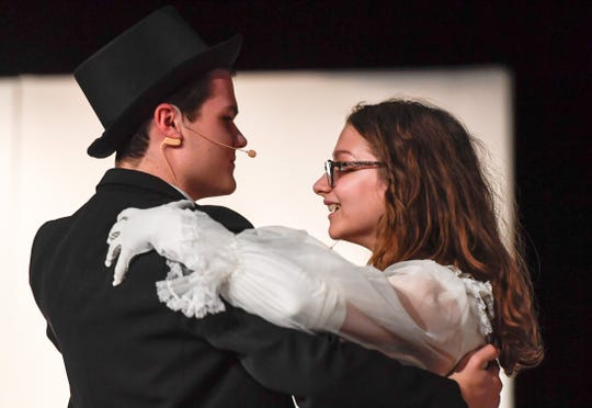 """Henry Higgins, played by Joby Beasley, and Eliza Doolittle, played by Katie Ivie, dance the waltz during a dress rehearsal of the Henderson County High's School of Fine Arts production of Lerner and Loewe's """"My Fair Lady"""" March 21-24 at the school's auditorium Tuesday, March 19, 2019."""