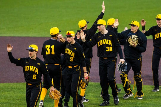 Iowa's Connor McCaffery (30) high-fives teammate Iowa infielder Matthew Sosa (31) after a NCAA non conference baseball game against Simpson College on Tuesday, March 19, 2019, at Duane Banks Field in Iowa City, Iowa.